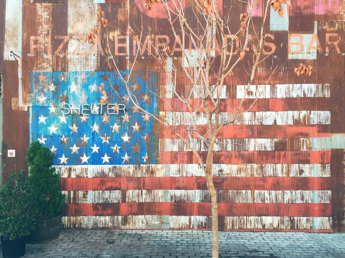 America on a tin backdrop in Williamsburg