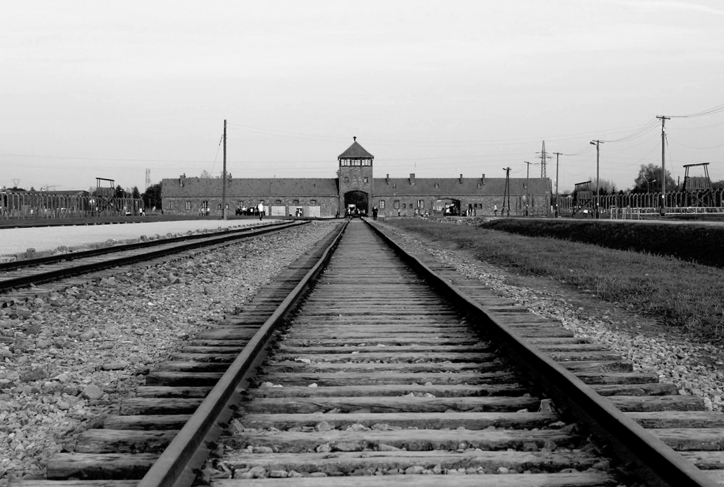 Auschwitz II – Birkenau. The main SS guard tower also known as gate of death. The railroad spur and ramp ran from the main gate towards the gas chambers and crematoria.