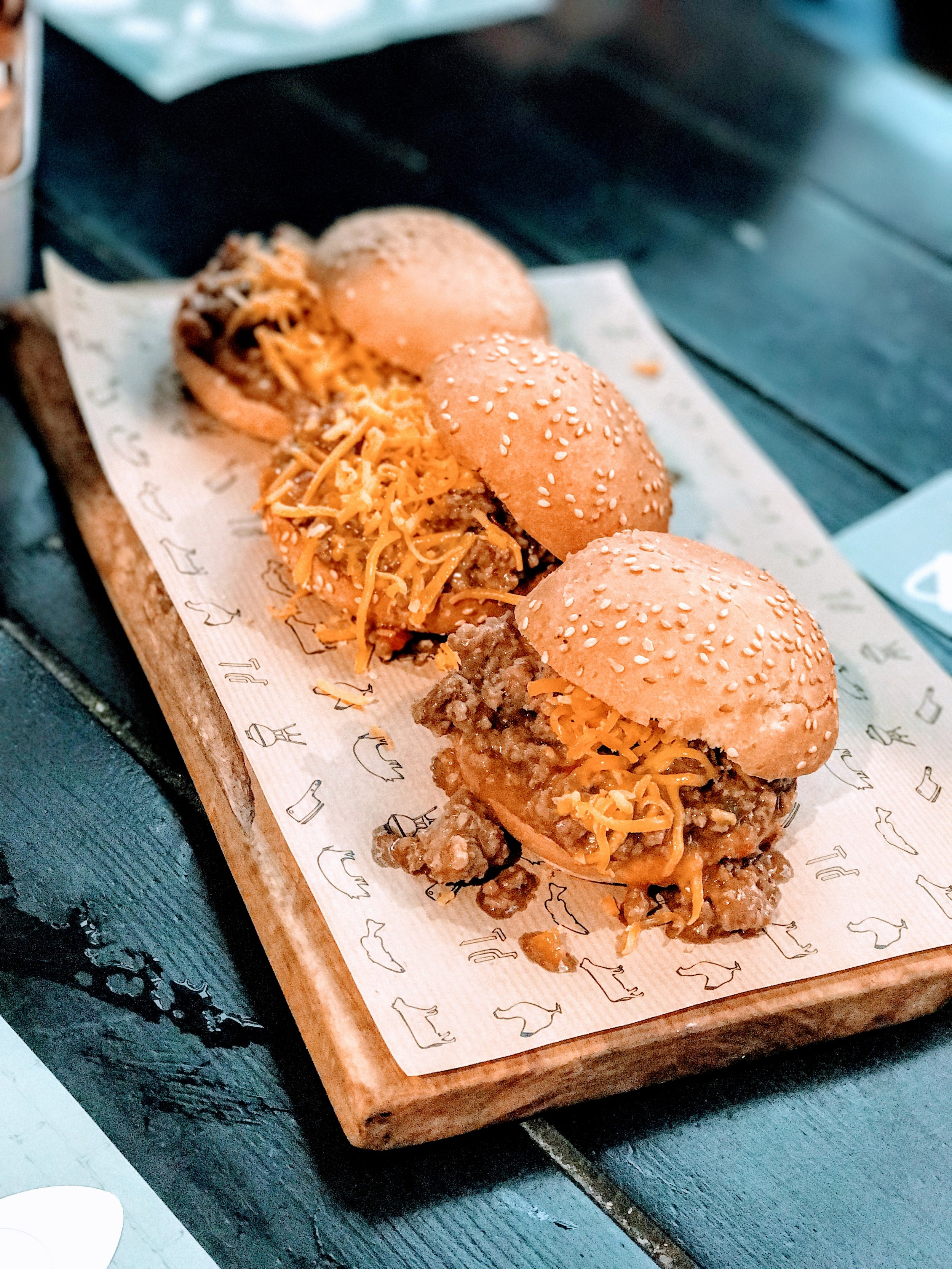 Sliders filled with shredded mature cheddar cheese and minced meat