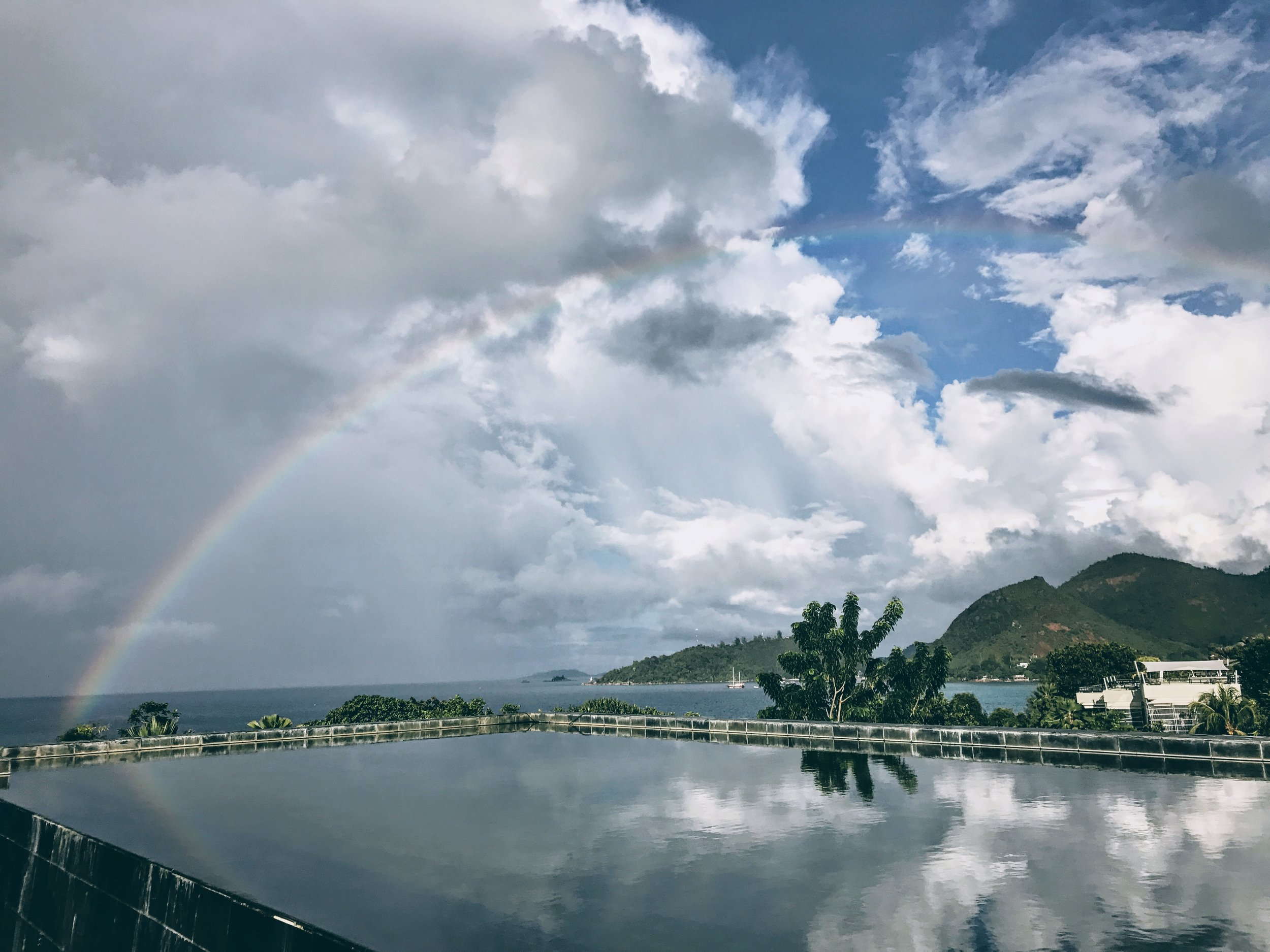 A rainbow appeared after a rain shower at this Zen like retreat.