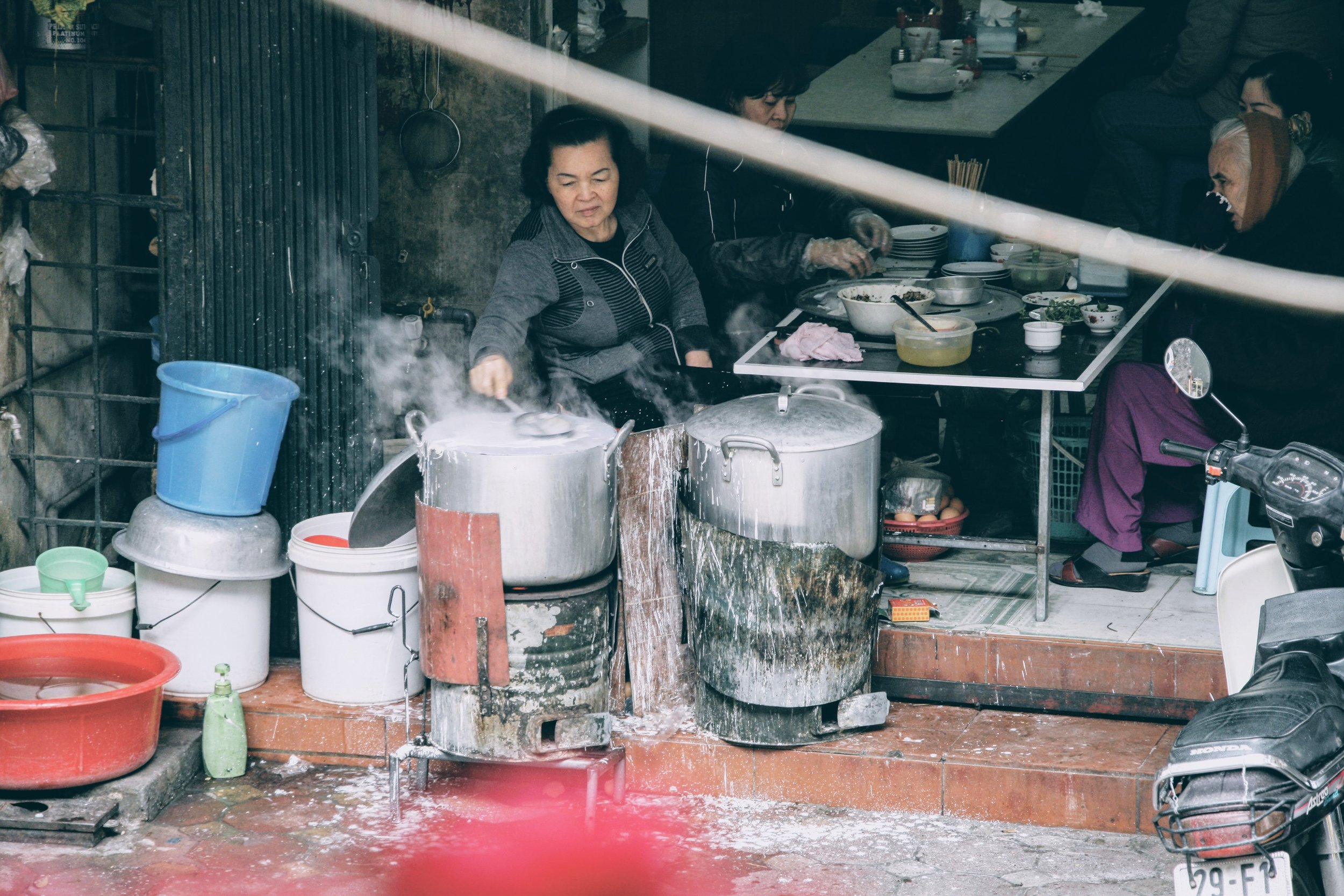 Ladling each scoop of the rice flour-based batter onto the steamer, covering it with a lid for a matter of seconds, then carefully transferred the gossamer-thin sheets with a bamboo stick onto a tray to be filled with minced mushrooms and pork