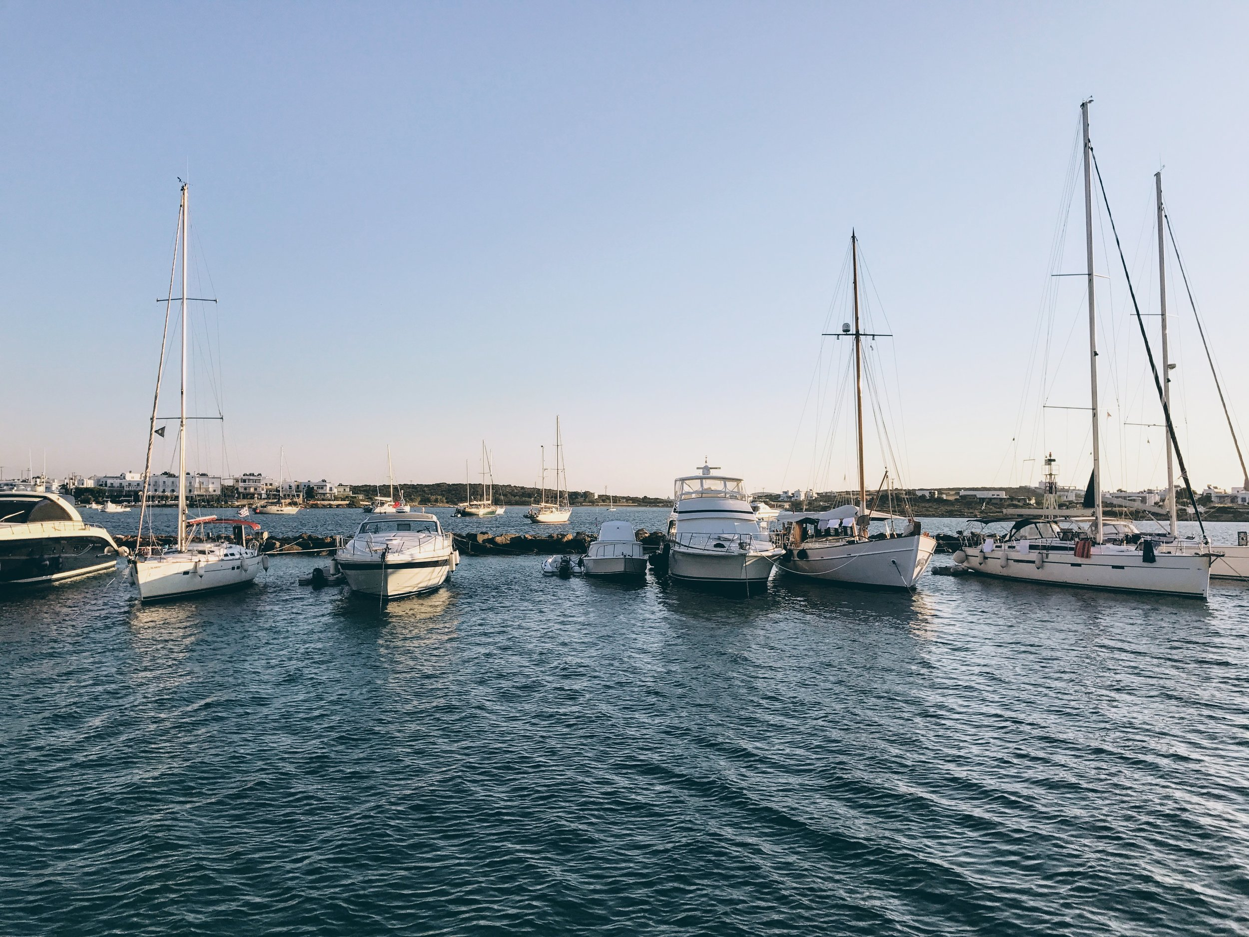 Sailing boats by the port