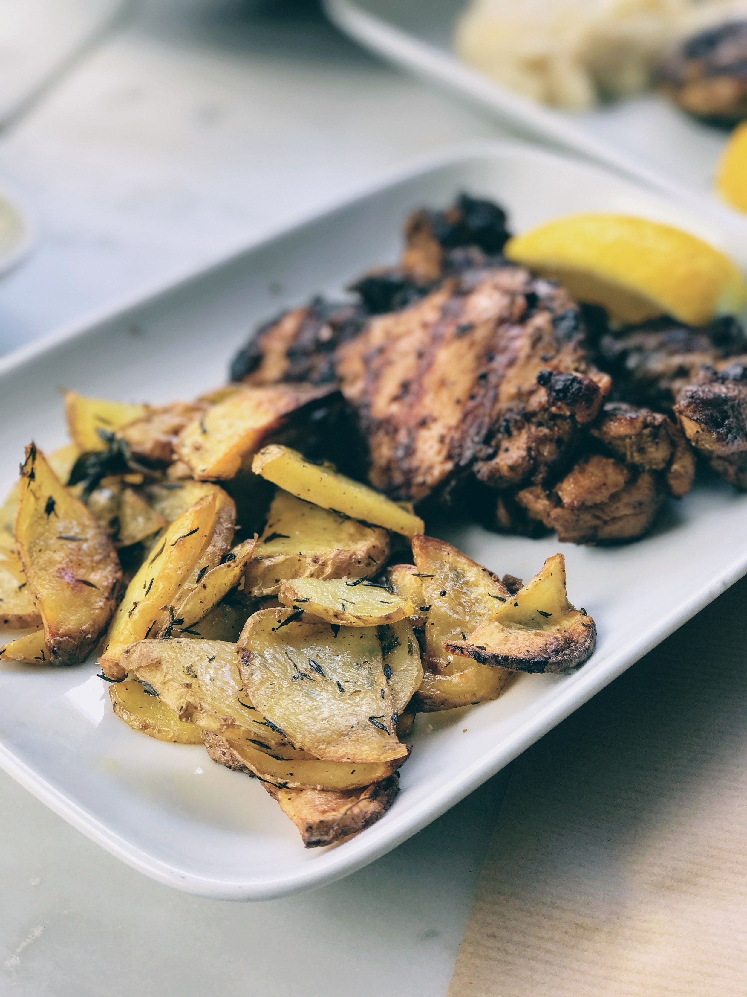 Tender chicken thigh fillets with oven-cooked potatoes