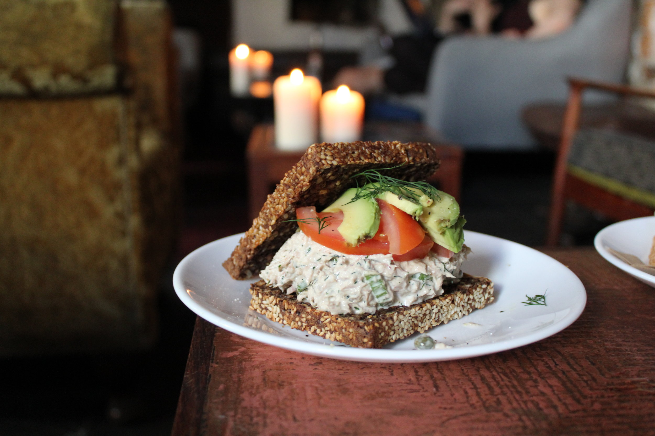 A tuna and avocado sandwich on rye at The Living Room