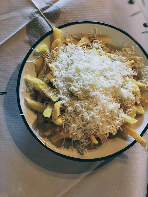 French fries sprinkled with grated Corinthian cheese