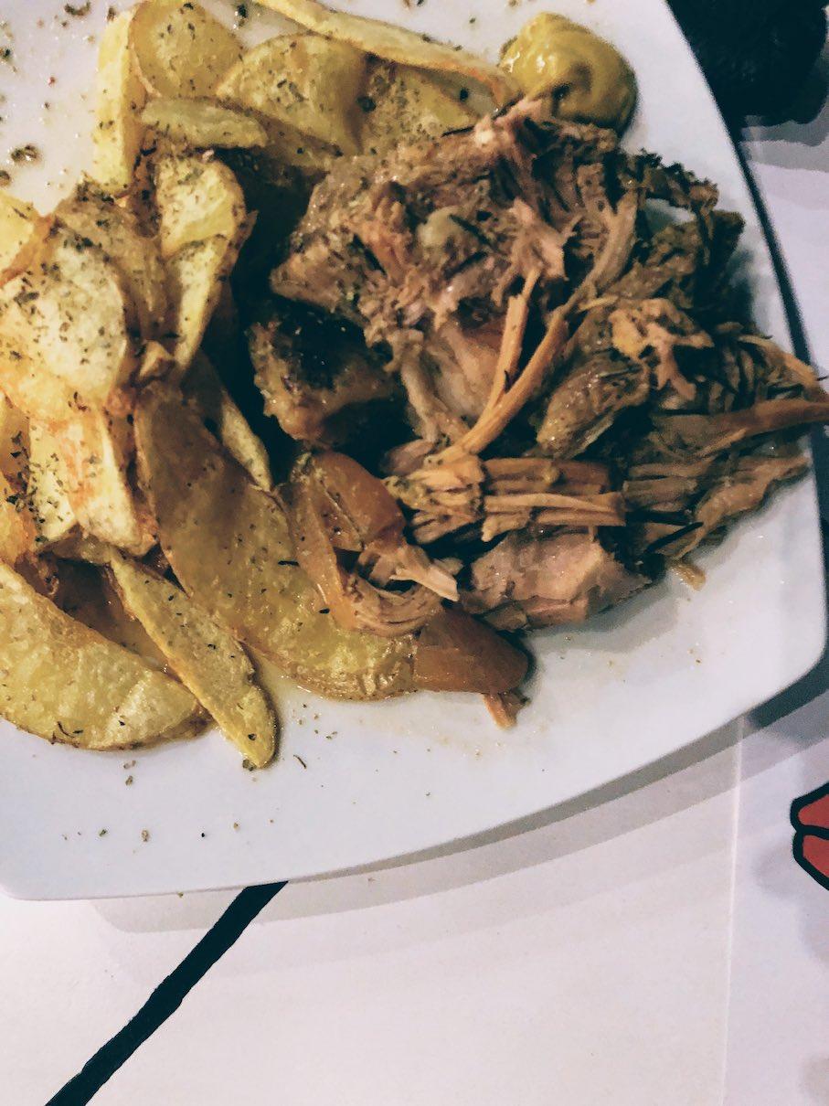 Pork stew in lemon sauce with thin-sliced fried potatoes