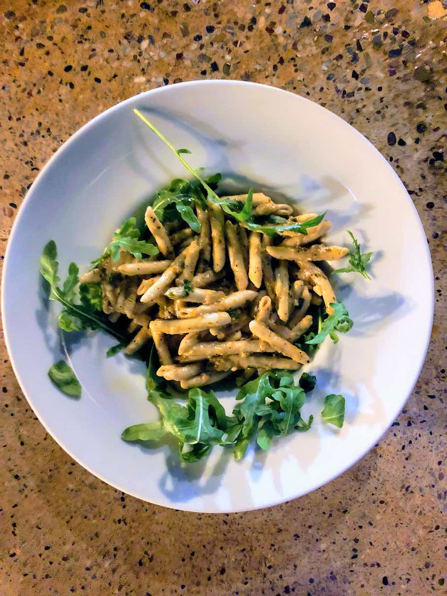 Traditional pasta from Crete with aubergine paste and rocket