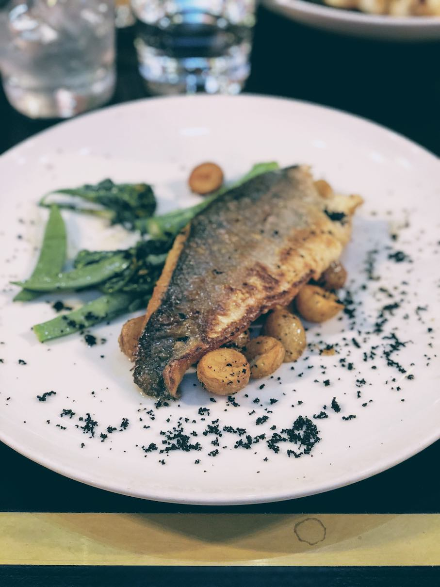 Grilled seabass with mini potatoes and snap pea