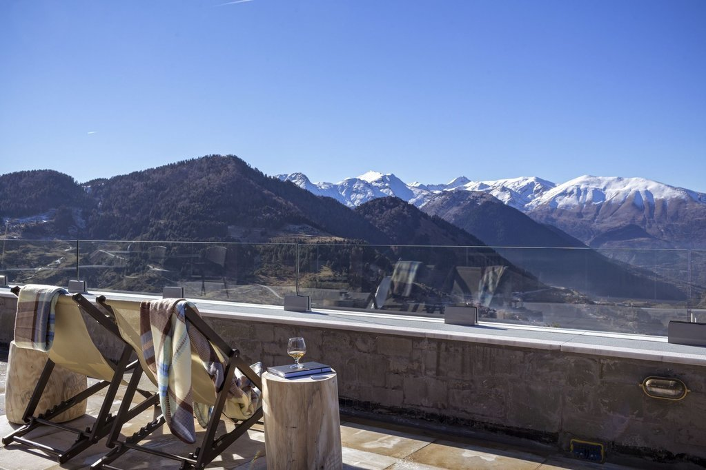 Relaxing in the sun at Grand Forest Metsovo, overlooking the snow-topped mountains
