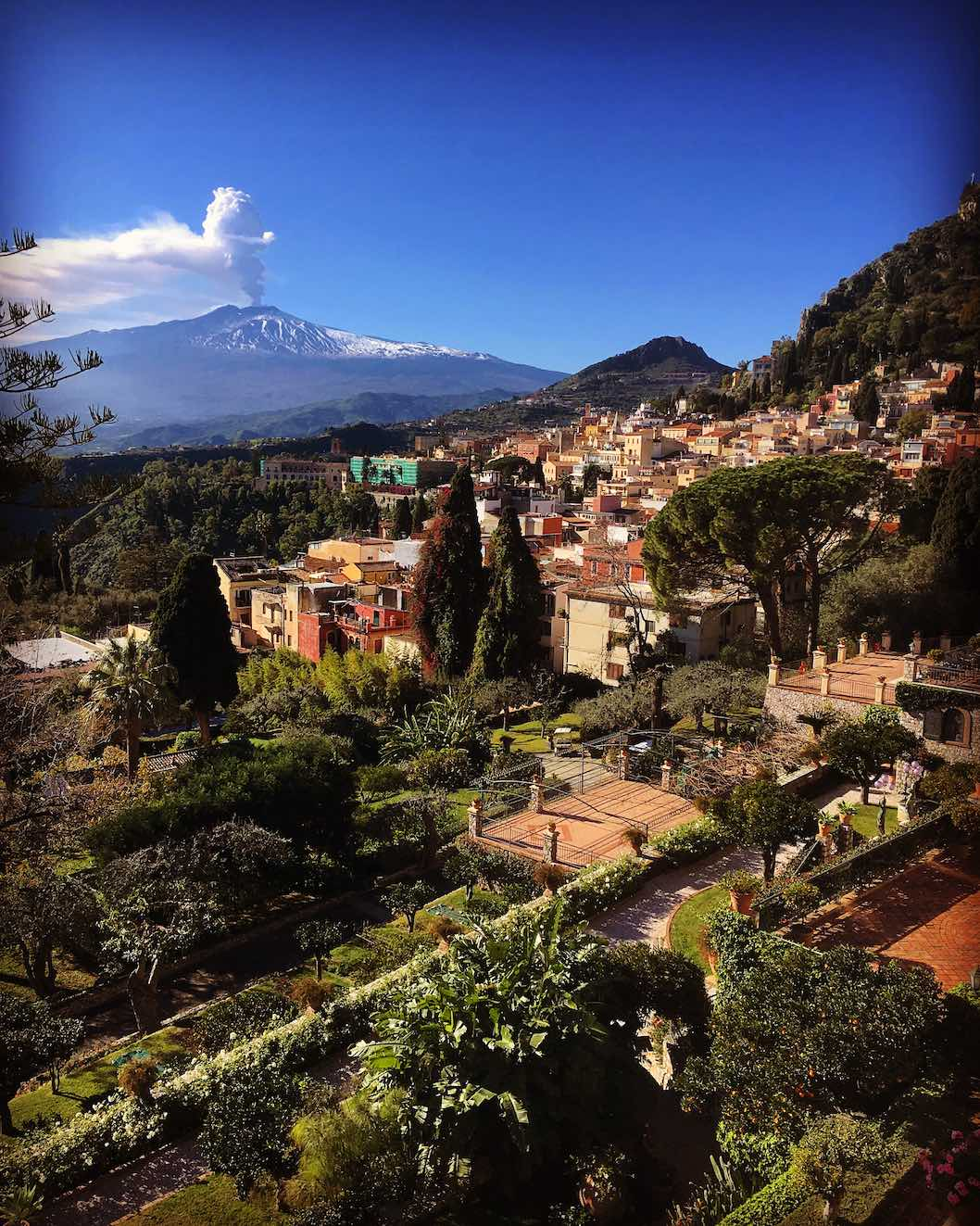 Taormina from the balcony of the Belmond with Mount Etna smoking in the distance