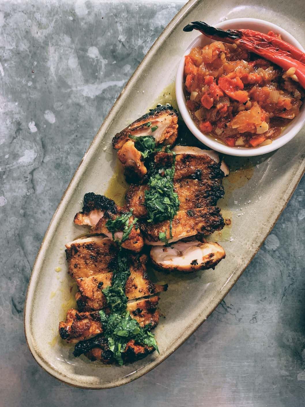 Harissa chicken with tomato, pepper & onion relish