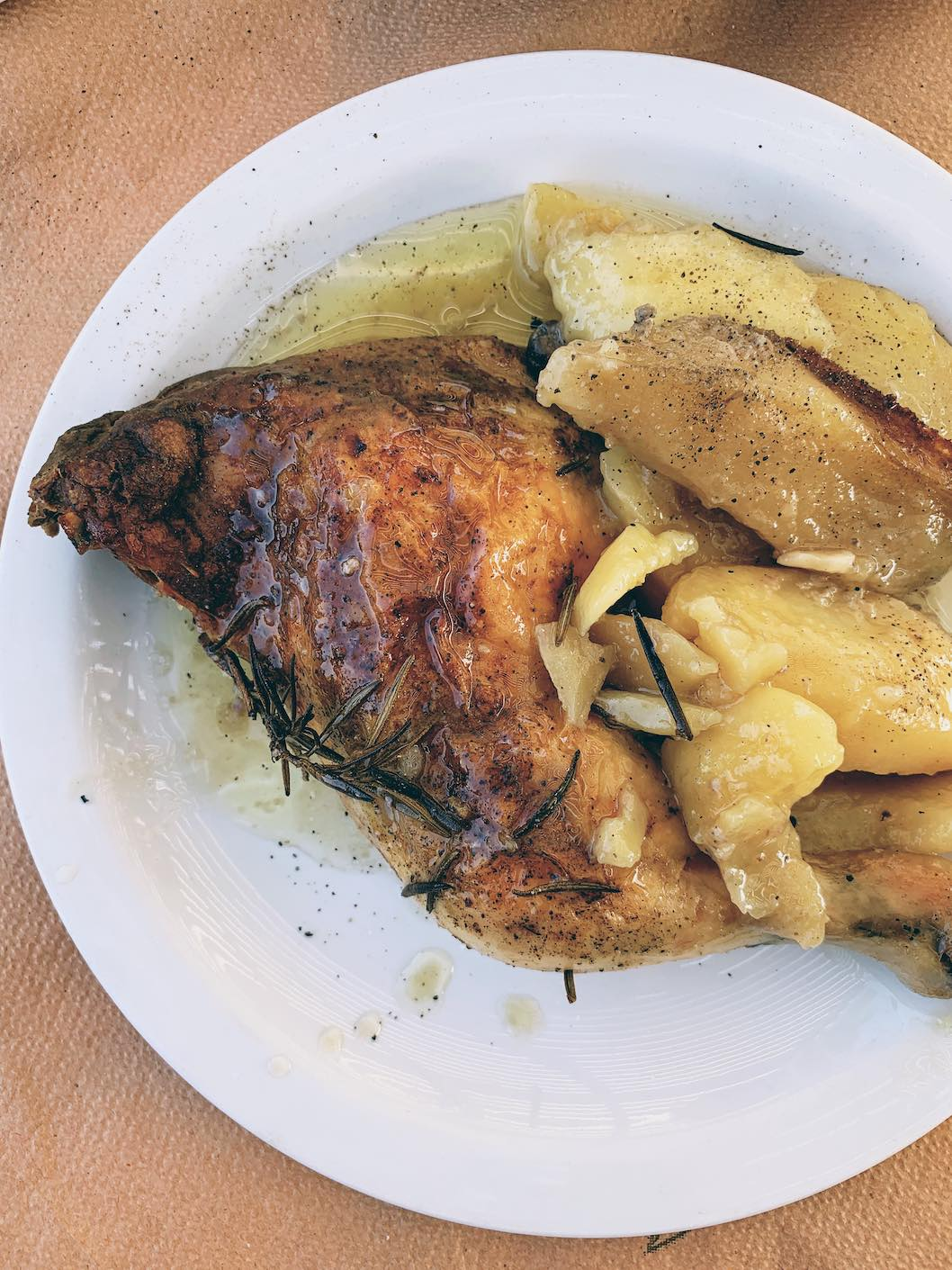 Rosemary chicken and potatoes baked in the wood-fired oven