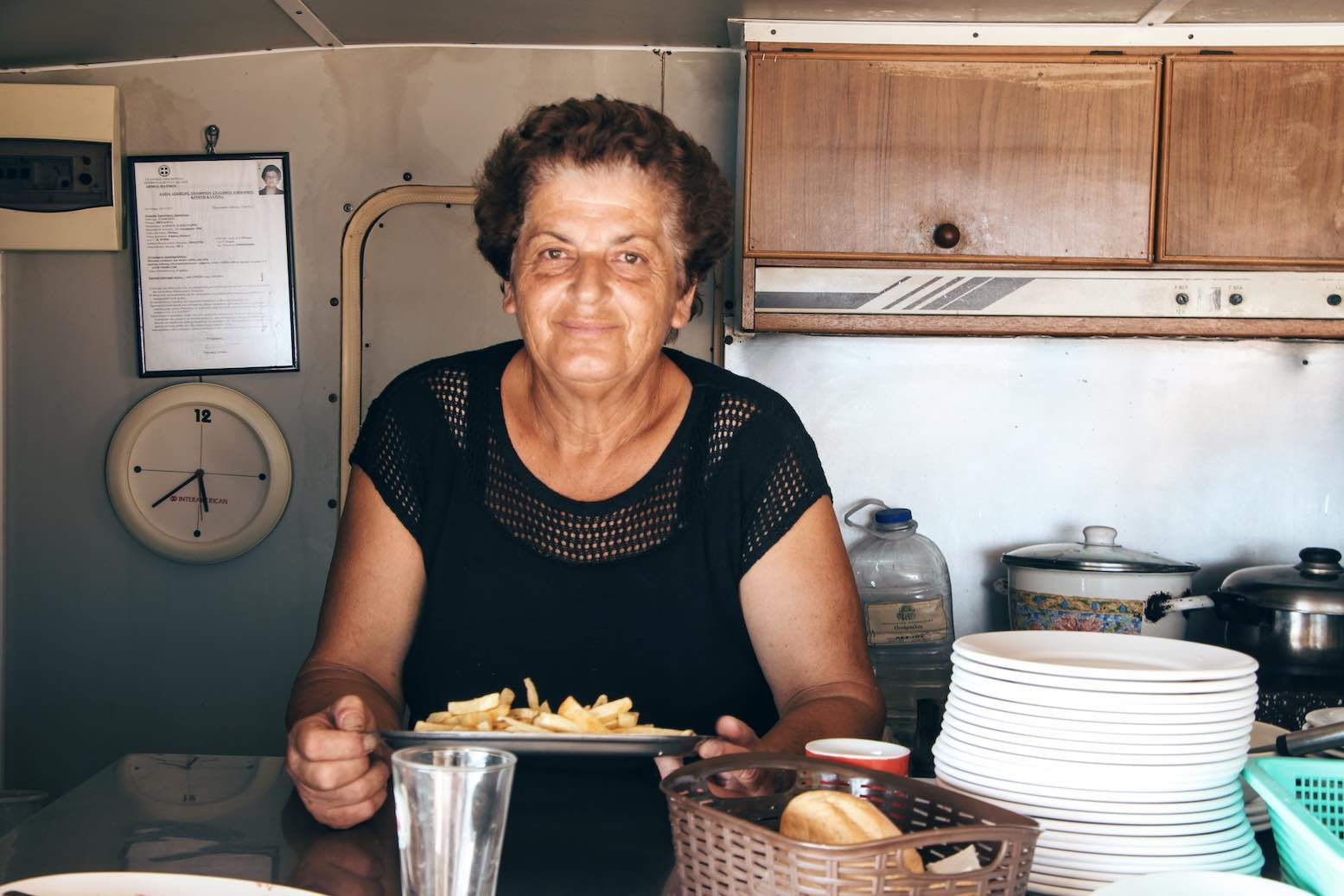 Mrs Theologia serving her freshly hand-cut french fries