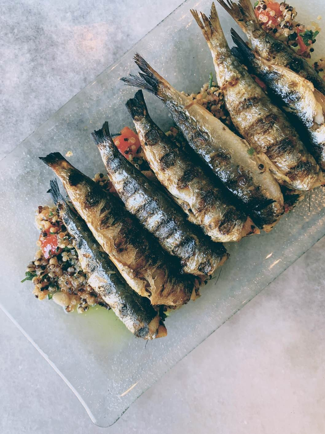 Grilled sardines on a bed of quinoa salad
