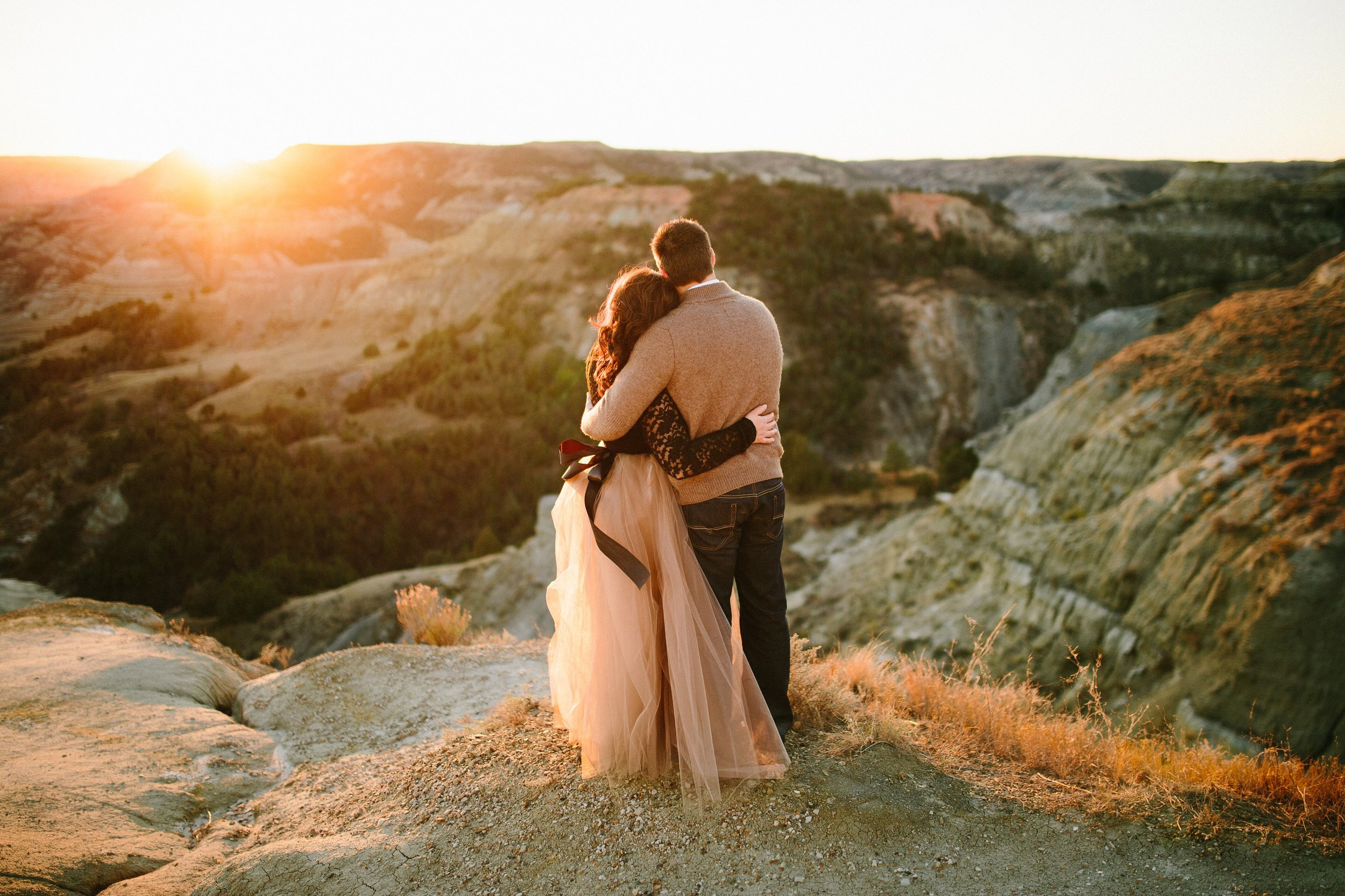 Romantic Sunset Couples Session at the Theodore Roosevelt National Park in North Dakota by Seattle WA destination photographer Janelle Elaine Photography with pink tulle skirt.jpg