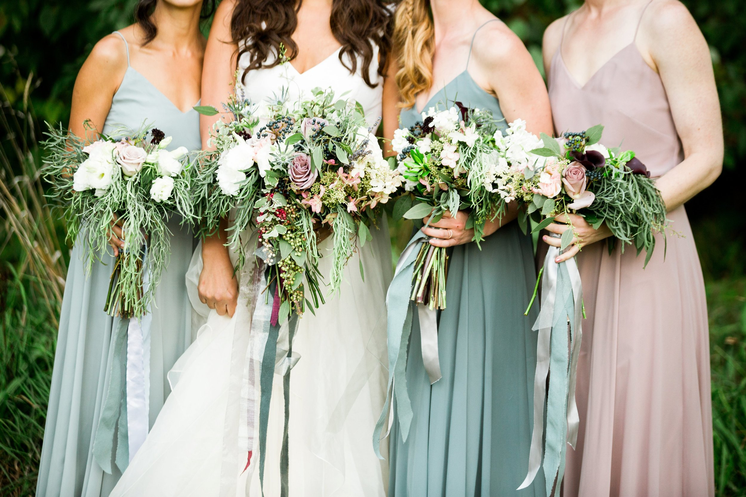blue mismatched bridesmaid dresses and bouquets by seattle photographer janelle elaine.jpg