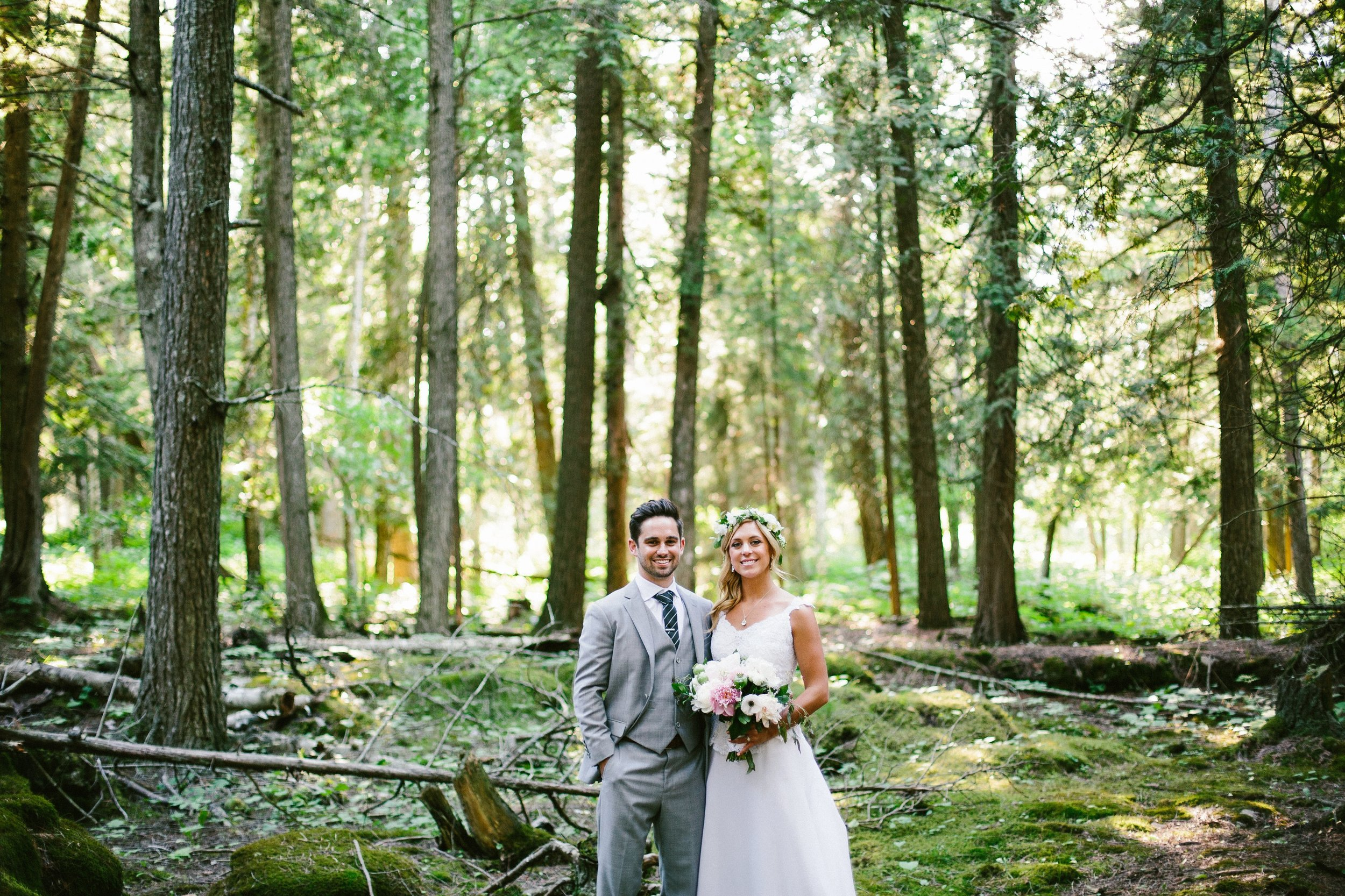 bride and groom portraits in the woods at gordon lodge wisconsin.jpg