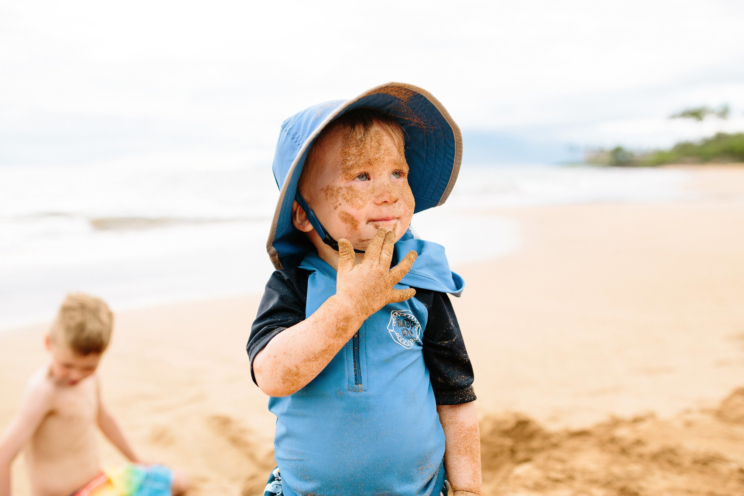Kid eating sand Family Beach Day Photo Session on Maui by Seattle Lifestyle Photographer Janelle Elaine Photography.jpg