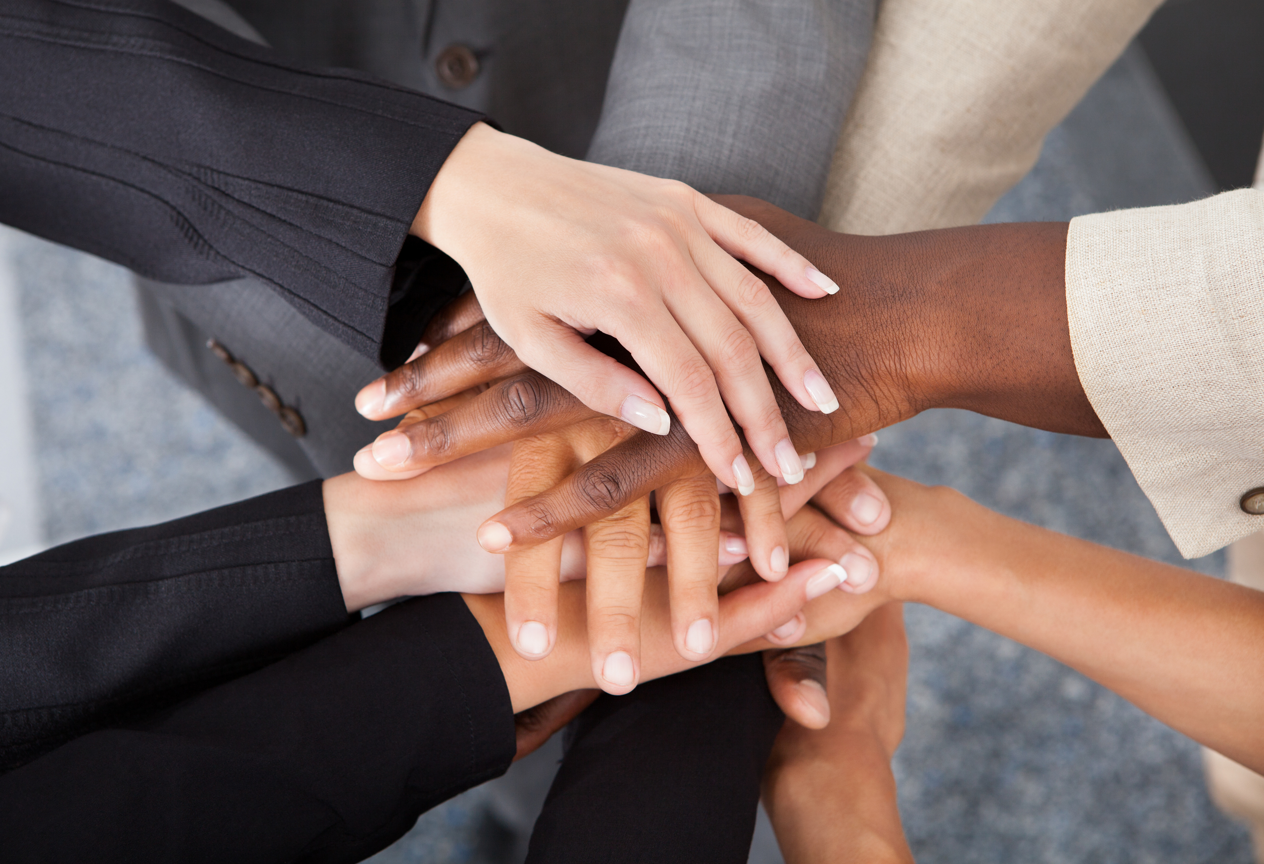 hands of multicultural business group