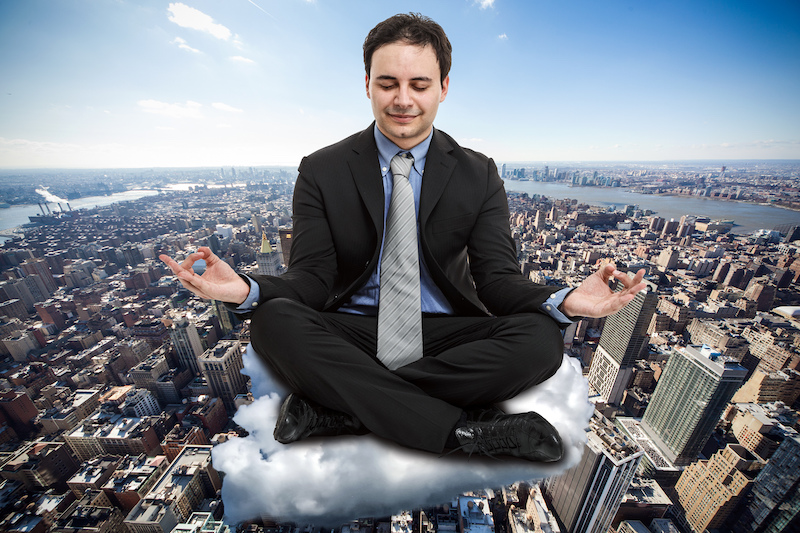 meditating professional over nyc