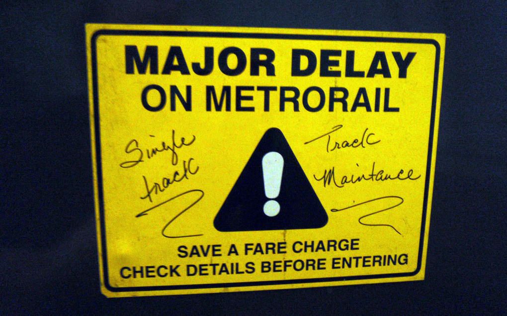 Error recovery:  Signs outside the paid station area alert DC Metrorail passengers to delays. Photo credit: Daniel Lobo, Flickr