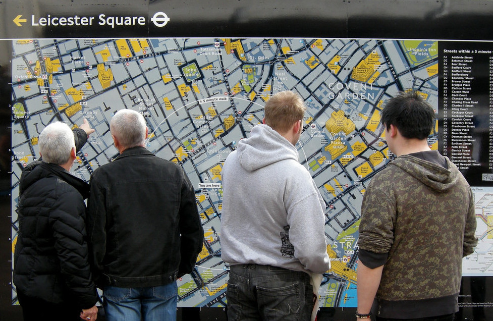 Pedestrians interact with a legible london map. Photo credit: Martin deutsch, flickr