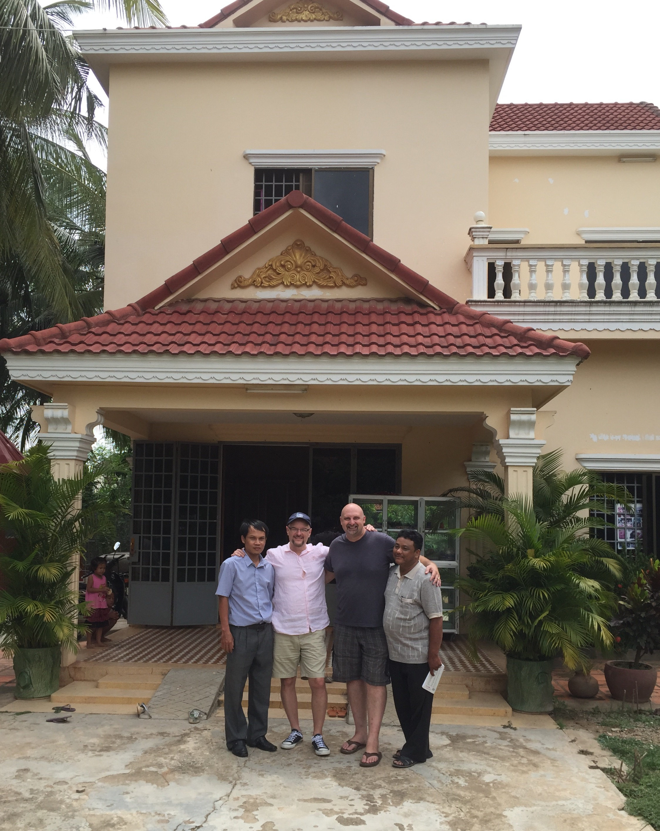 PK, John, Mark and Tong in front of the Esther's House facility