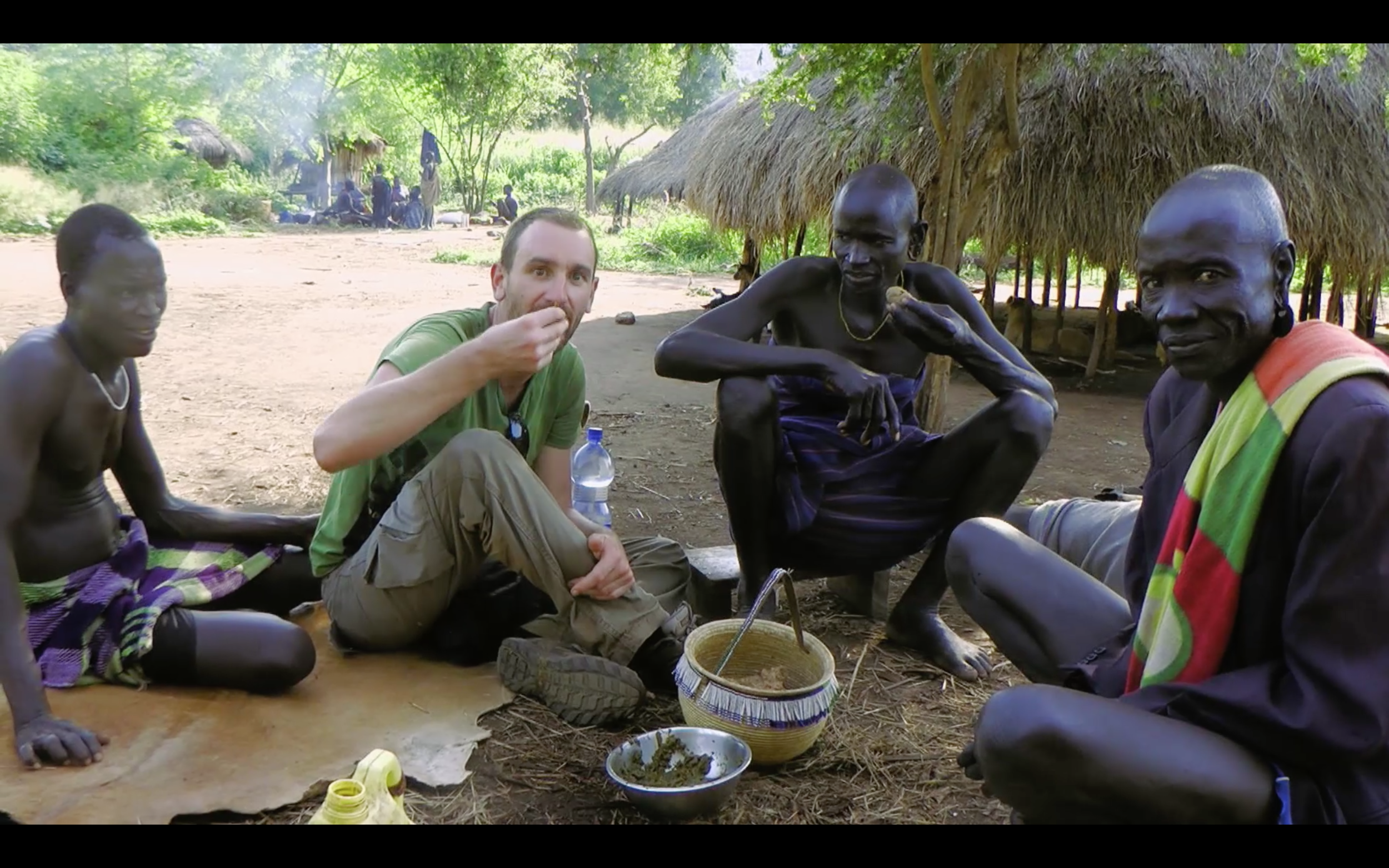 Eating tilla in a Mursi village - Walking With The Mursi