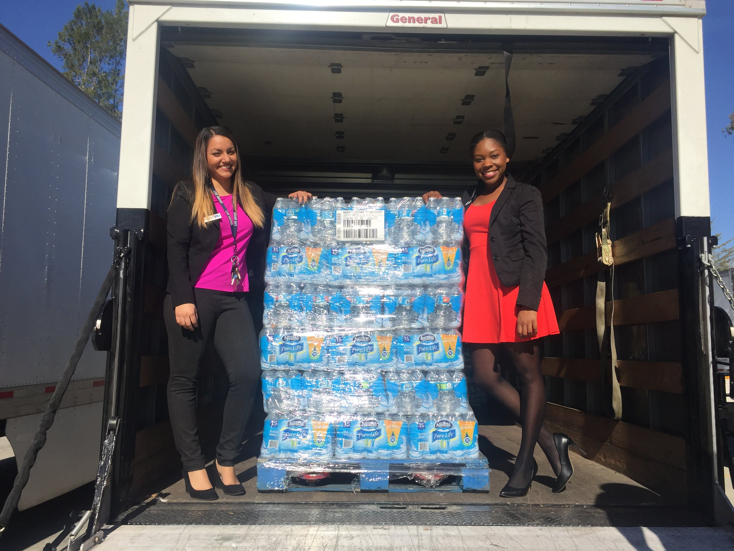 Jasmine and her coworker, Marie collect a Nestle Donation for the IEUW Kids Pack Program.