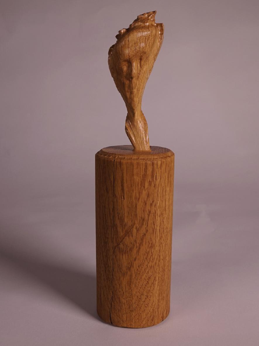 skewed wooden bust of self