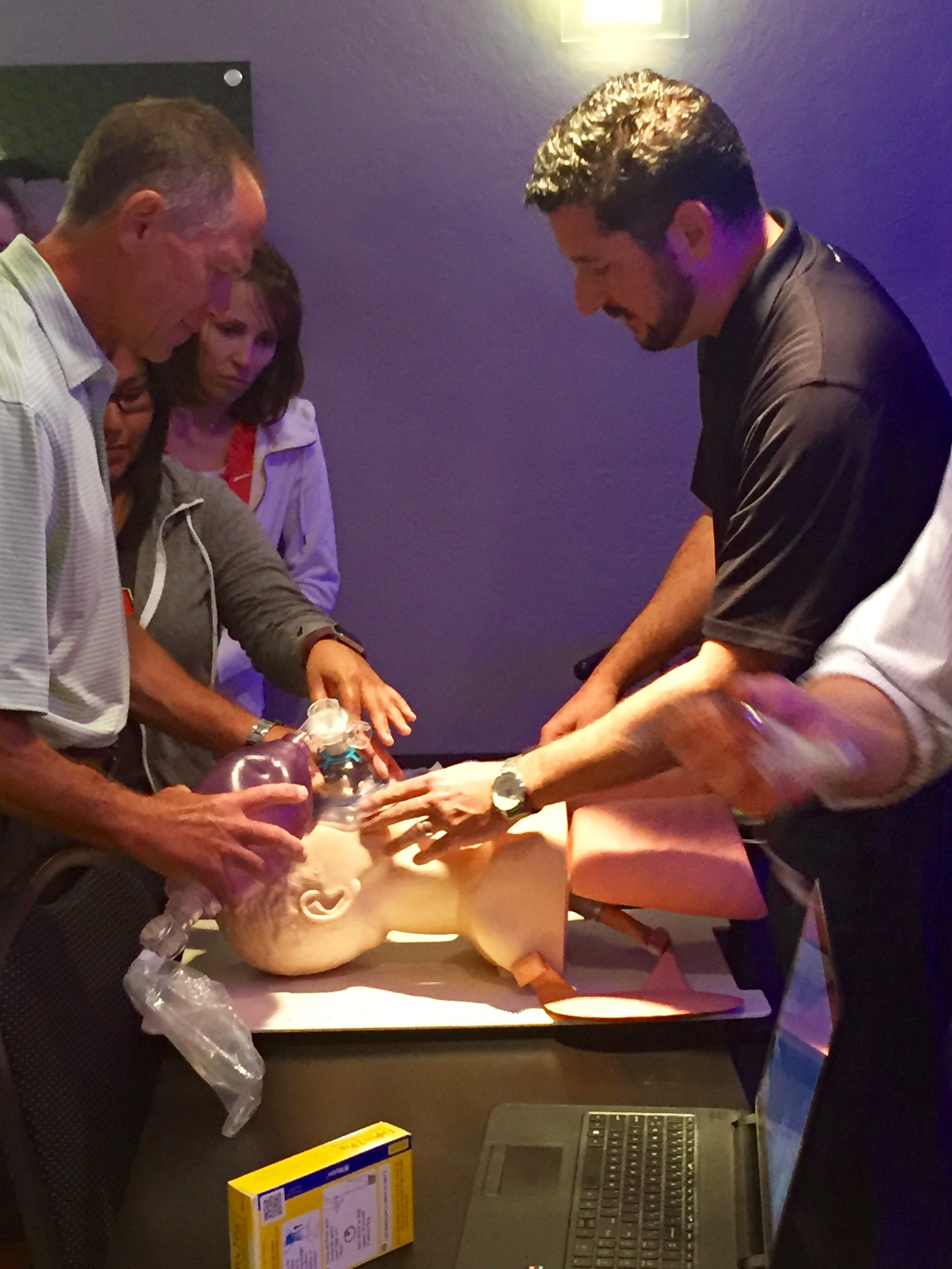 Ali J. Baghai, CRNA, demonstrating airway management techniques. Pictured here with Dr. Jorgenson, DDS.