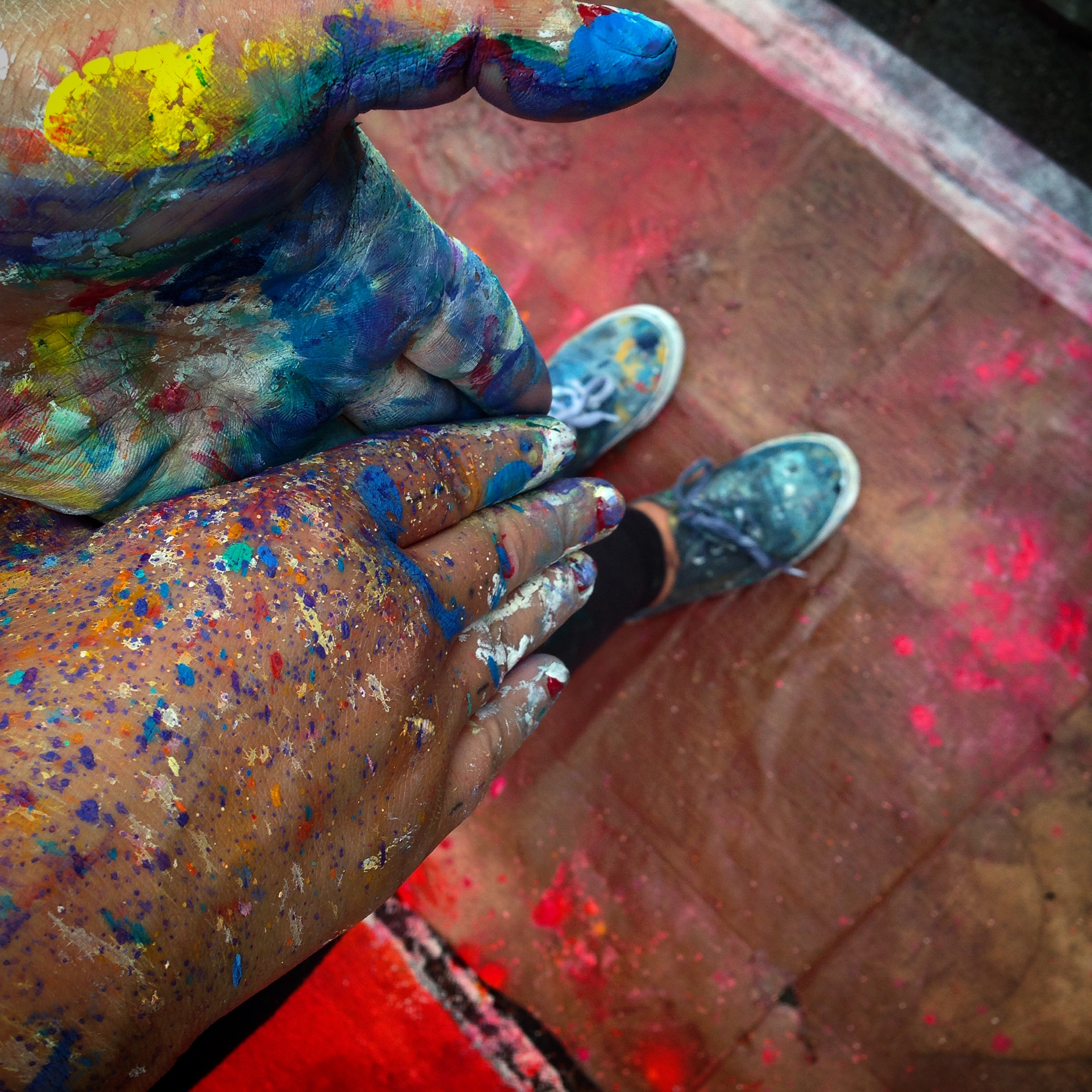 Pau at work covered in color. Image Courtesy of the artist