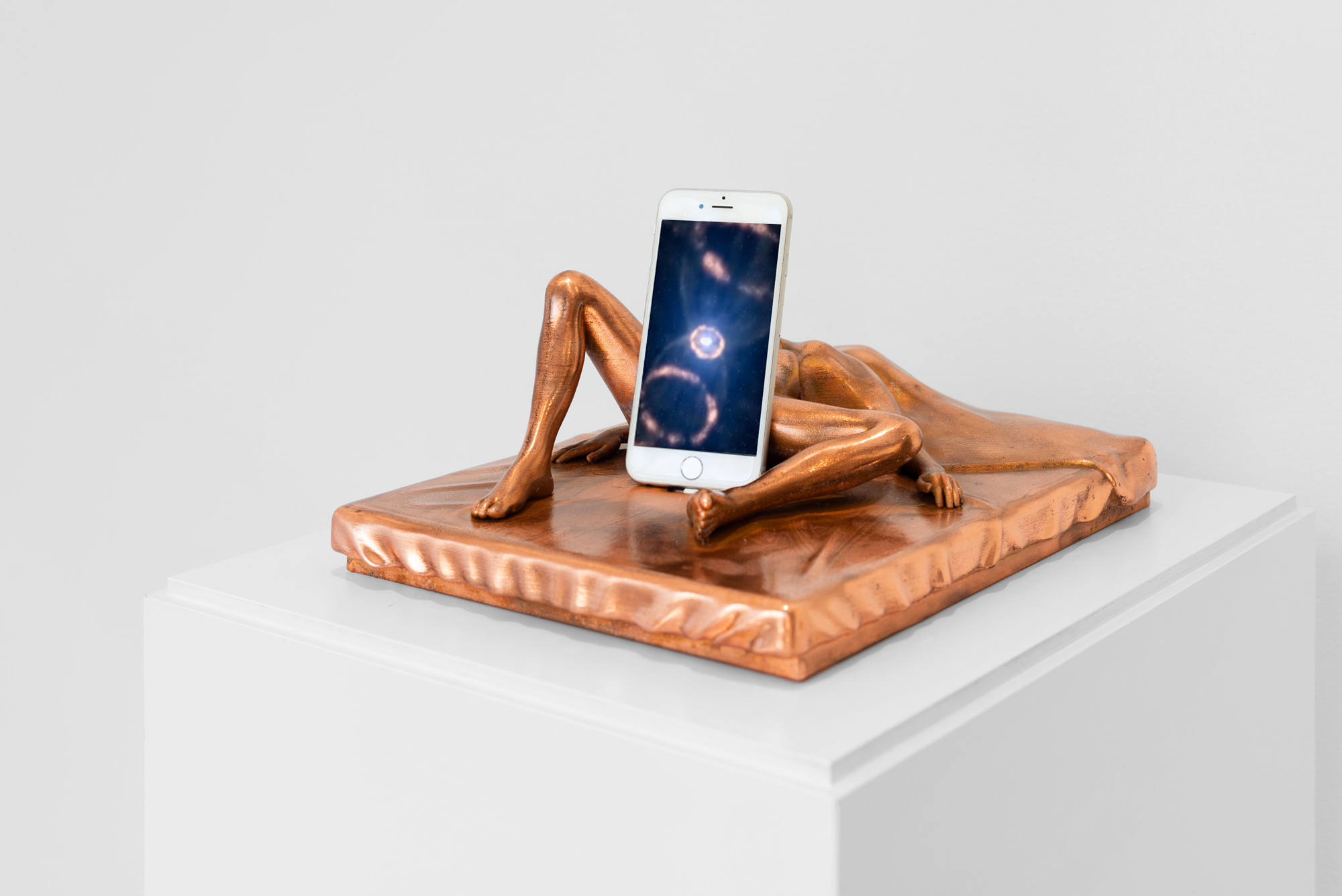 Origins of the Universe, 2017-2018 3D printed polyamide with copper plating, smart phone, fixed video, pedestal, plexi vitrine 5 x 10 x 13.4 in, sculpture 54.75 x 14 x 17.5 in © Courtesy of the artist