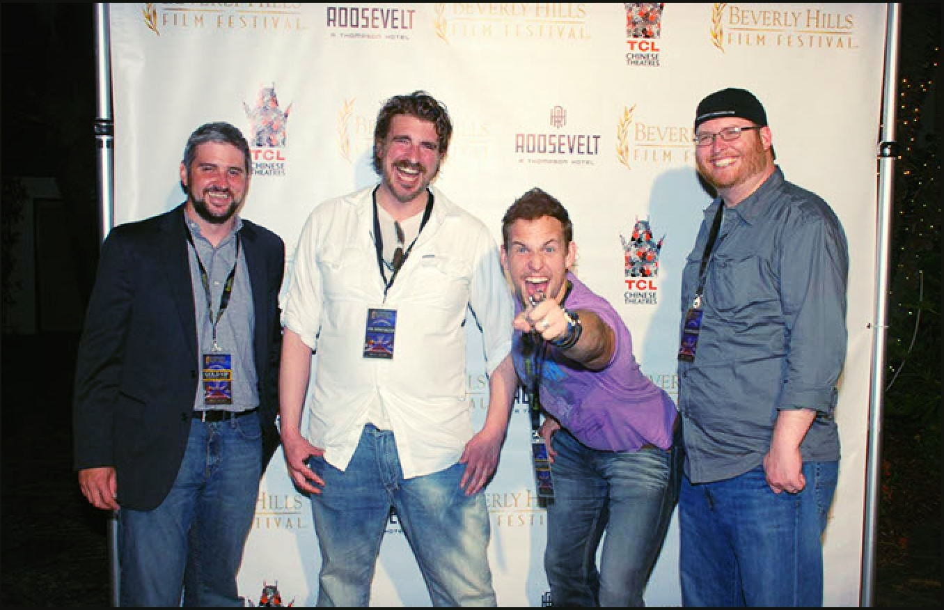 (from left to right)  Mike Collier II (Director of Photography), Levi A. Taylor (Co-Writer/Director), Bradford James Jackson (Co-Star Actor) D.K. Johnstorn (Co--Producer)  The Darkness premier at Beverly Hills Film Festival