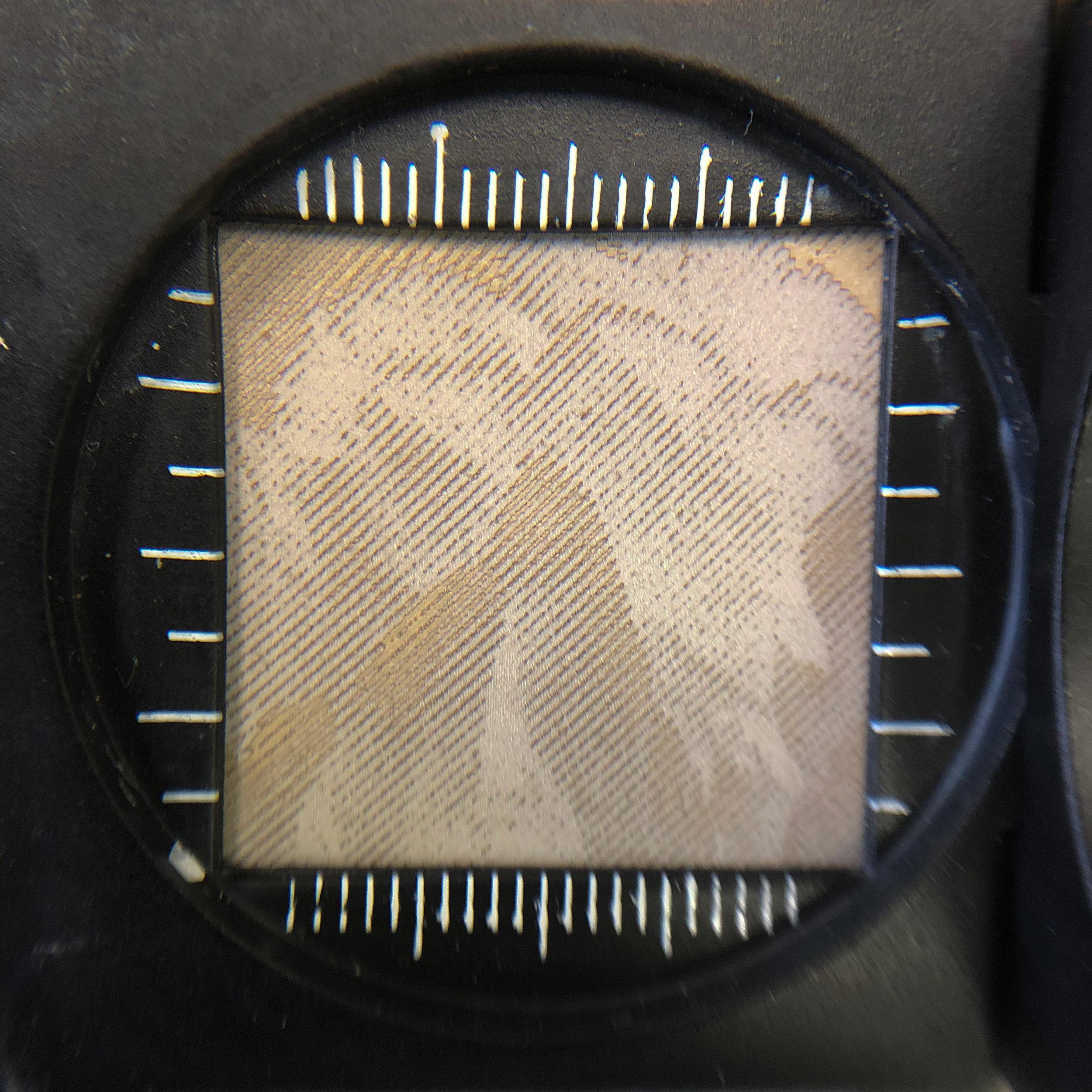 laser engraved stone under magnification