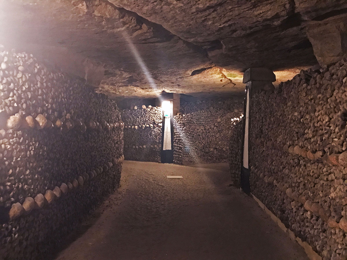 hallway of skeletons in Paris catacombs