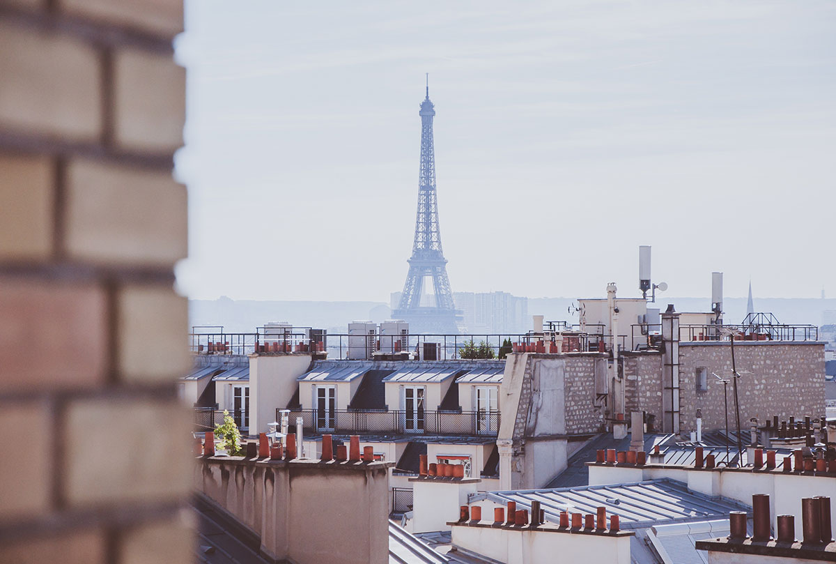 view of the Eiffel Tower from rooftops   Paris Neighborhoods Explained