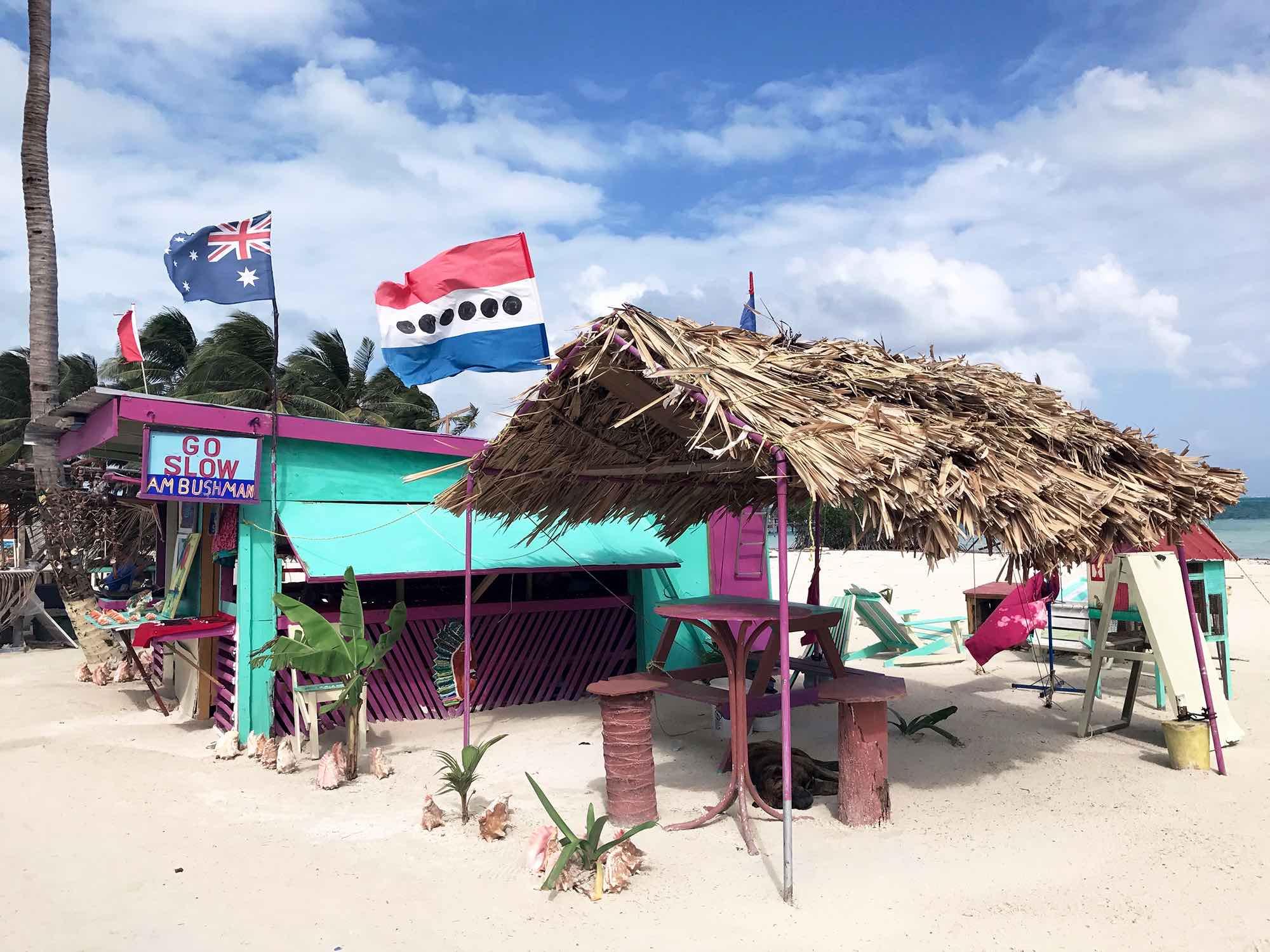 "Caye Caulker Belize motto ""go slow"""