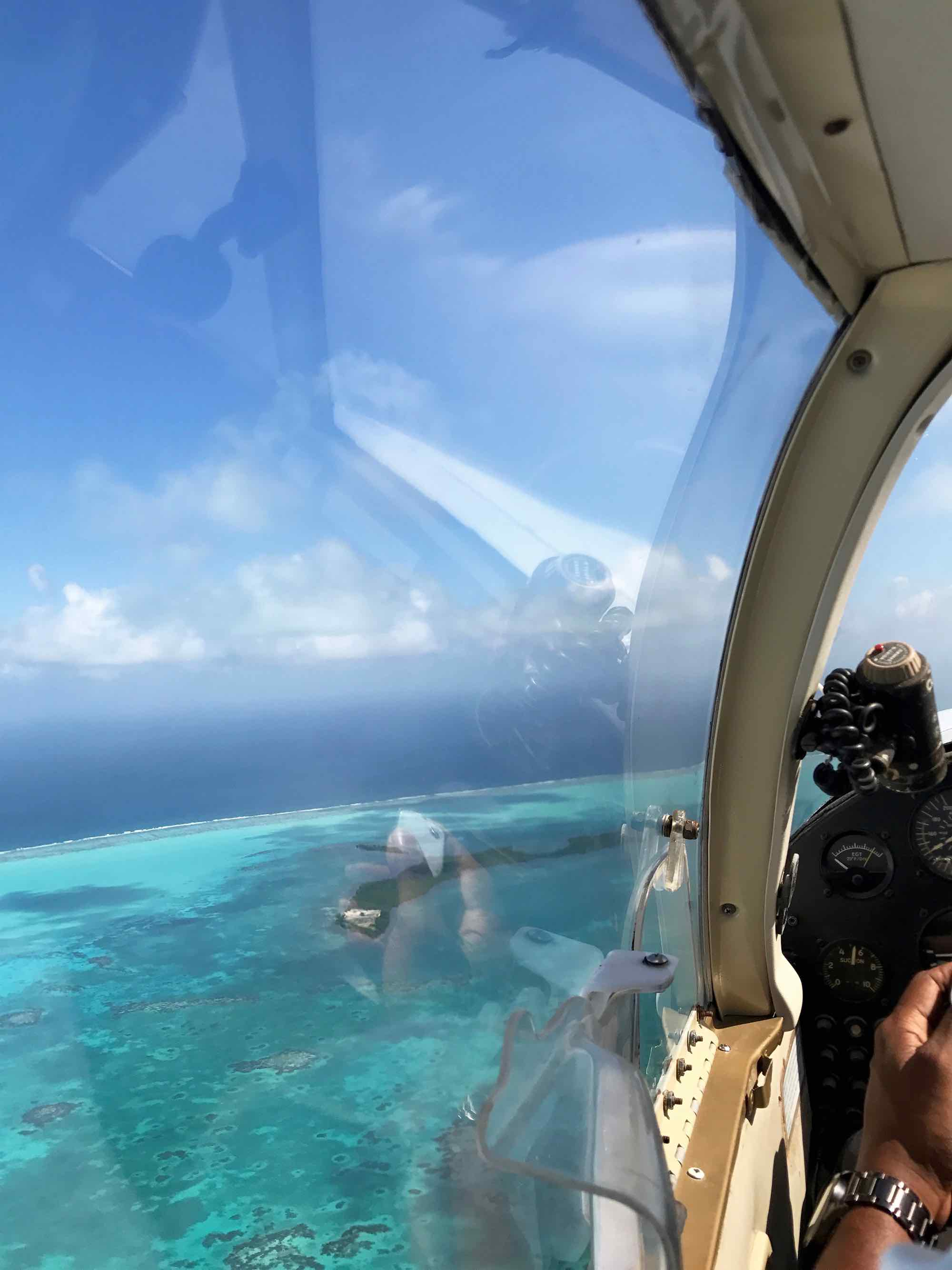 airplane cockpit flying over the Great Blue Hole, Belize