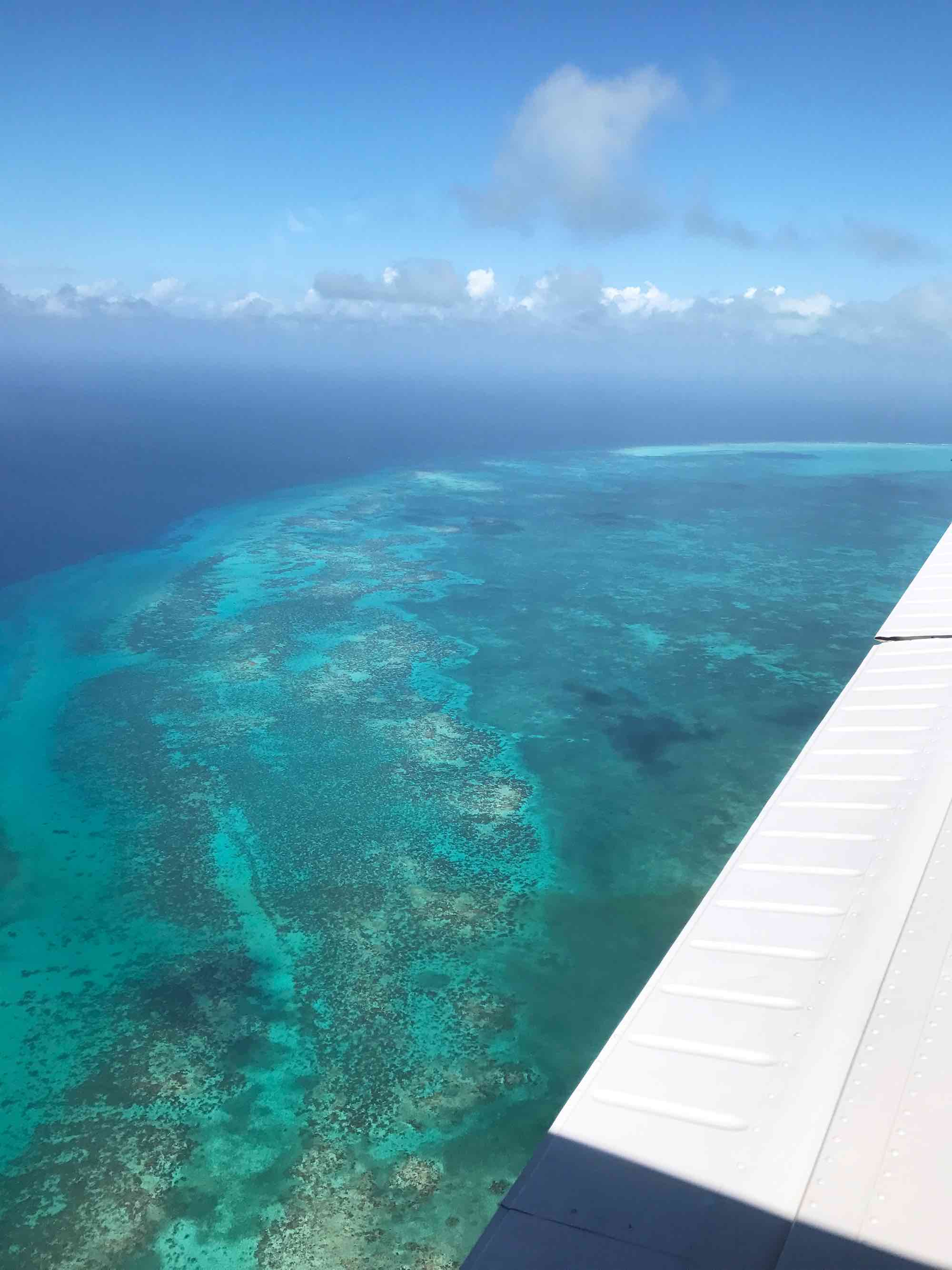 Flying over Belize to the Great Blue Hole