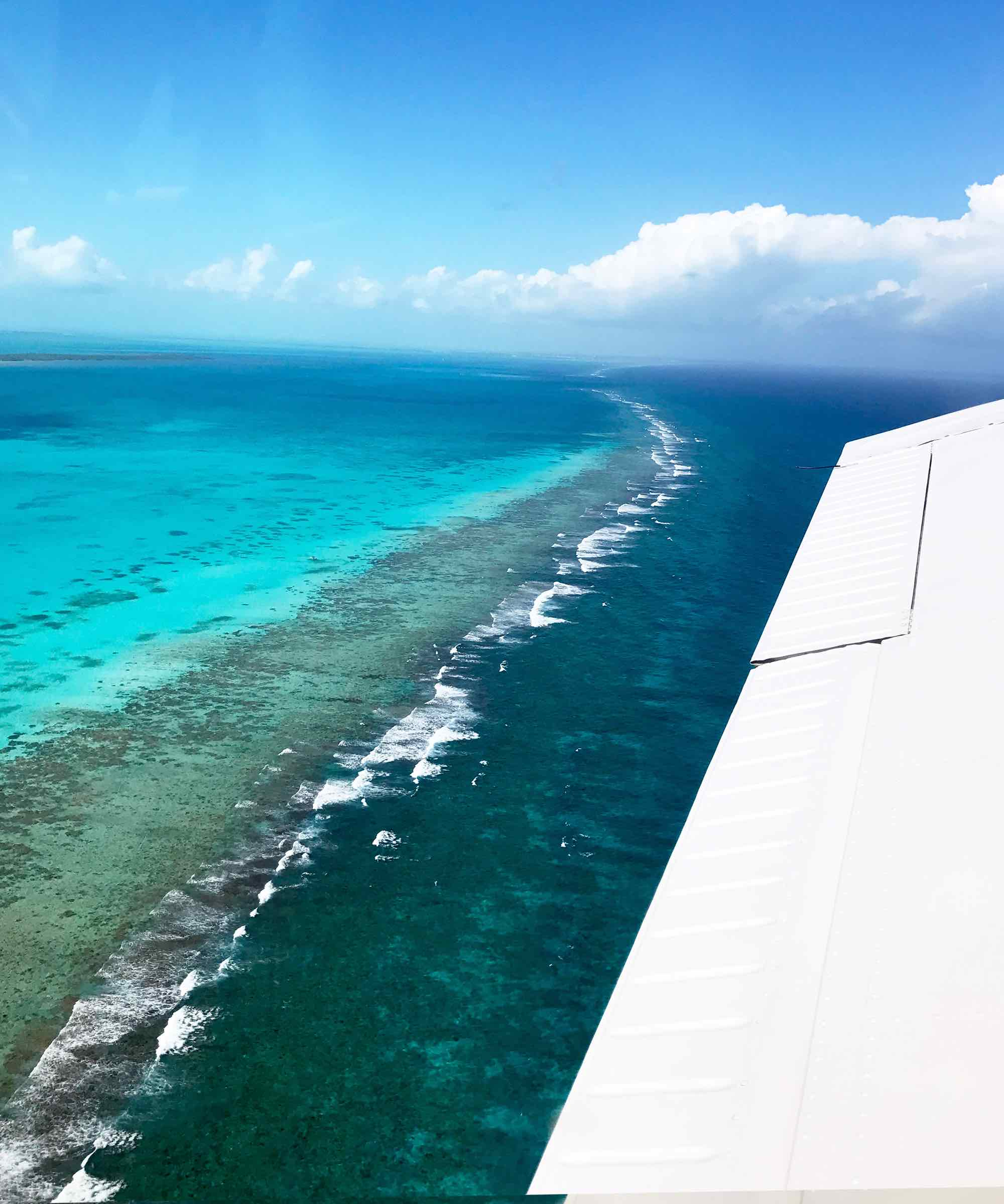 Flying over the Belize Barrier Reef to the Blue Hole