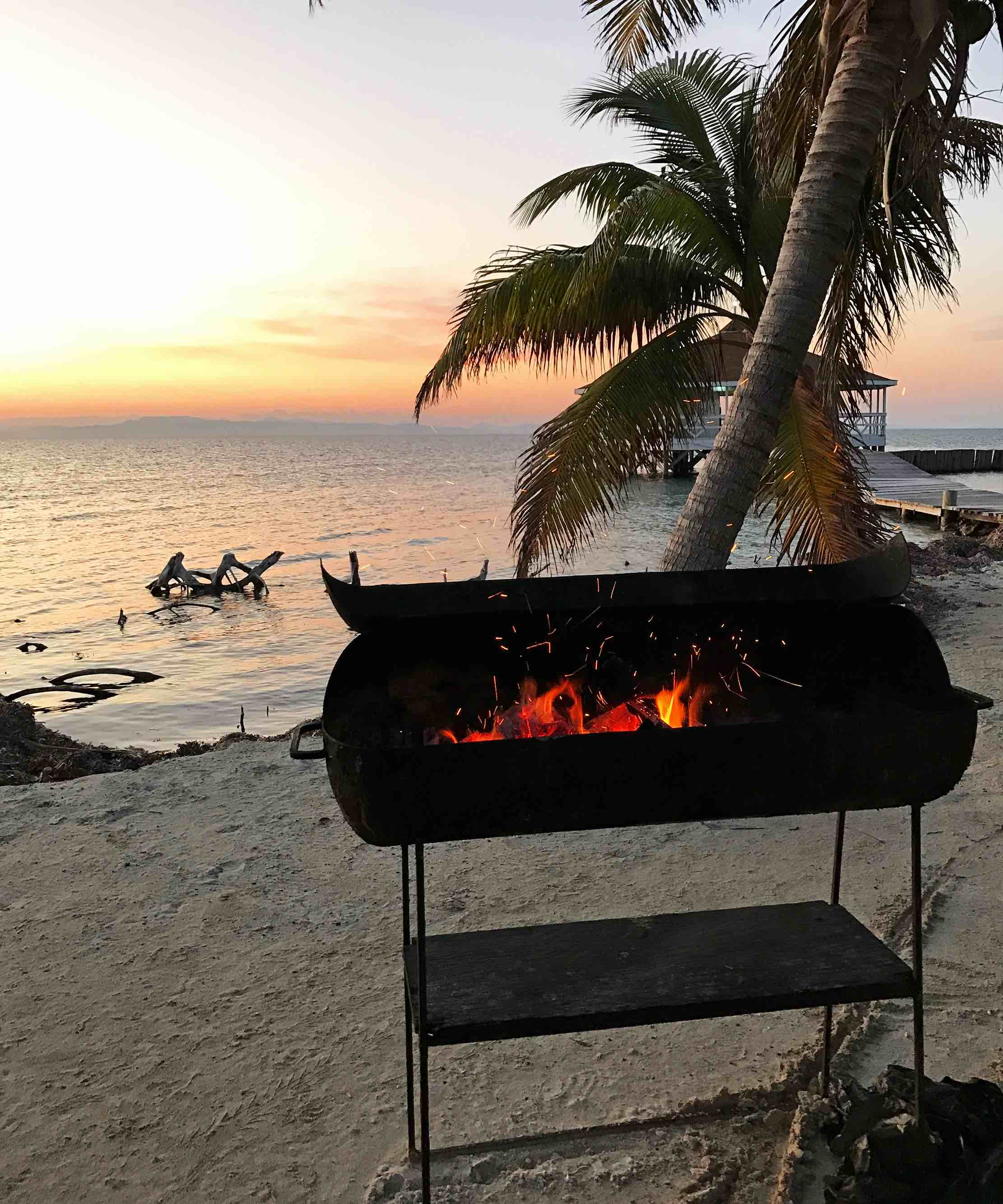 sunset lobster BBQ while sailing in Belize