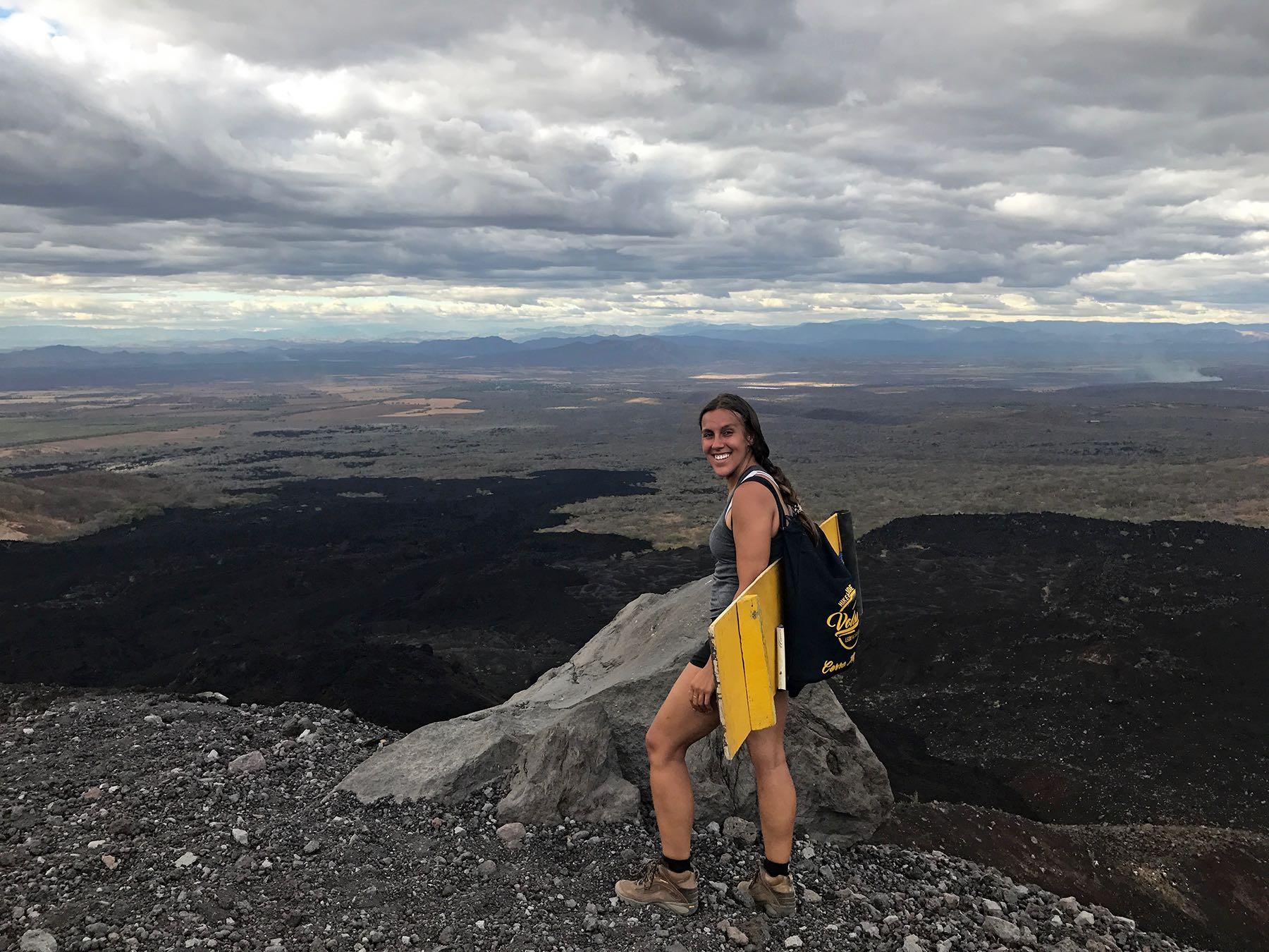 Sapphire & Elm Co-Founder, Stephanie Hiking up Cerro Negro for Volcano Boarding