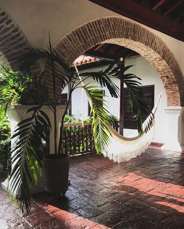 "Who else is a big fan of these antiquated, colonial cities in Central and South America with their intricate wood and brick architecture, courtyards, hammocks, and lots of plants? 🌿⠀⠀⠀⠀⠀⠀⠀⠀⠀ ⠀⠀⠀⠀⠀⠀⠀⠀⠀ Cartagena, Colombia.⠀⠀⠀⠀⠀⠀⠀⠀⠀ ⠀⠀⠀⠀⠀⠀⠀⠀⠀ Antigua, Guatemala. ⠀⠀⠀⠀⠀⠀⠀⠀⠀ ⠀⠀⠀⠀⠀⠀⠀⠀⠀ Granada, Nicaragua. ⠀⠀⠀⠀⠀⠀⠀⠀⠀ ⠀⠀⠀⠀⠀⠀⠀⠀⠀ I highly recommend slow traveling through these cities so you can properly enjoy adequate leisure time being cradled in a hammock, reading, napping or listening to your favorite podcasts while rocking in the breeze. ⠀⠀⠀⠀⠀⠀⠀⠀⠀ ⠀⠀⠀⠀⠀⠀⠀⠀⠀ You deserve some rest of your vacation!⠀⠀⠀⠀⠀⠀⠀⠀⠀ ⠀⠀⠀⠀⠀⠀⠀⠀⠀ I'm home-free right now (the past 2.5 years!) but that's not stopping me from a little ""window shopping"" for a hammock for when I do decide to nest. 🐣⠀⠀⠀⠀⠀⠀⠀⠀⠀ ⠀⠀⠀⠀⠀⠀⠀⠀⠀ #slowtravel⠀⠀⠀⠀⠀⠀⠀⠀⠀ #traveldeeper⠀⠀⠀⠀⠀⠀⠀⠀⠀ #wekeepmoments⠀⠀⠀⠀⠀⠀⠀⠀⠀ #voyaged⠀⠀⠀⠀⠀⠀⠀⠀⠀ #wanderxwonder⠀⠀⠀⠀⠀⠀⠀⠀⠀ #forbestravelguide⠀⠀⠀⠀⠀⠀⠀⠀⠀ #lifelessonsfromtravel⠀⠀⠀⠀⠀⠀⠀⠀⠀ #goopgo⠀⠀⠀⠀⠀⠀⠀⠀⠀ #mydominetravels⠀⠀⠀⠀⠀⠀⠀⠀⠀ #iamatraveler⠀⠀⠀⠀⠀⠀⠀⠀⠀ #tlpicks⠀⠀⠀⠀⠀⠀⠀⠀⠀ #travelerincolombia⠀⠀⠀⠀⠀⠀⠀⠀⠀ #traveladvisor⠀⠀⠀⠀⠀⠀⠀⠀⠀ #travelconsultant⠀⠀⠀⠀⠀⠀⠀⠀⠀ #travelplanner⠀⠀⠀⠀⠀⠀⠀⠀⠀ #travelagentlife⠀⠀⠀⠀⠀⠀⠀⠀⠀ #likeajetsetter⠀⠀⠀⠀⠀⠀⠀⠀⠀ #travelvibes⠀⠀⠀⠀⠀⠀⠀⠀⠀ #colombiatravel⠀⠀⠀⠀⠀⠀⠀⠀⠀ #visitcolombia⠀⠀⠀⠀⠀⠀⠀⠀⠀ #colombiatravellers"