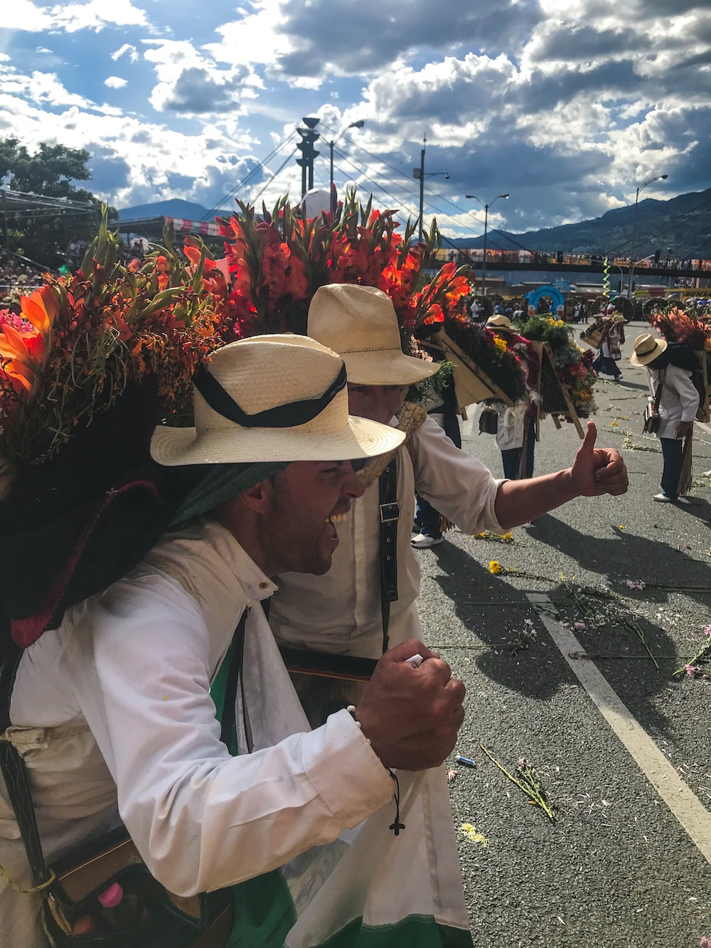 spirited silleteros at the flower festival parade in Medellin