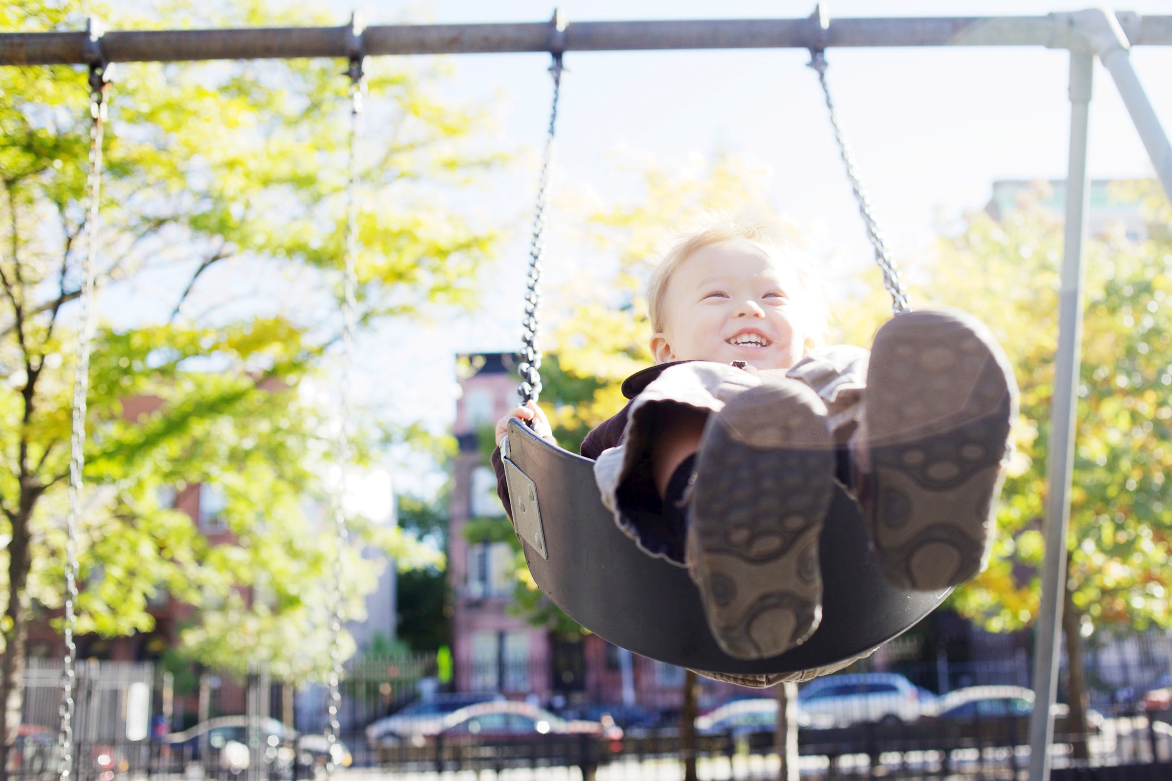 Have your child sit on the swing facing away from the sun if possible!