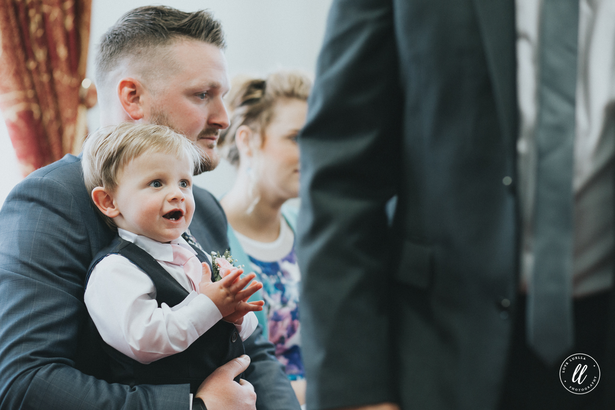 Candid moment in the llandudno town hall wedding ceremony