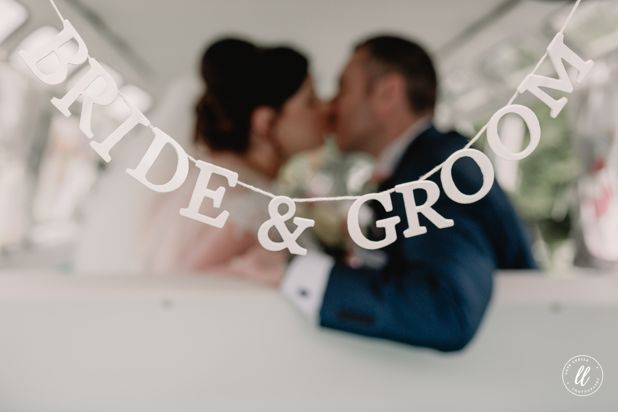 The bride and Groom in their Split the difference wedding van