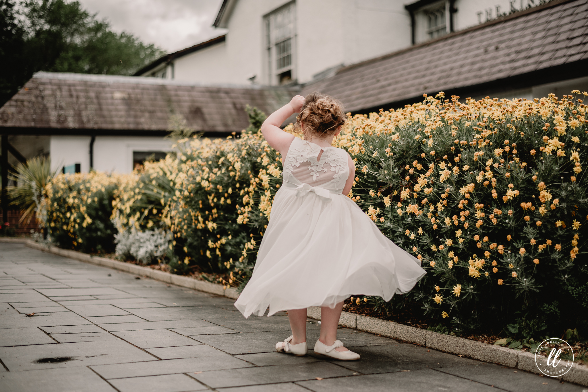 A twirling flower girl outside The Kinmel and Kinspa