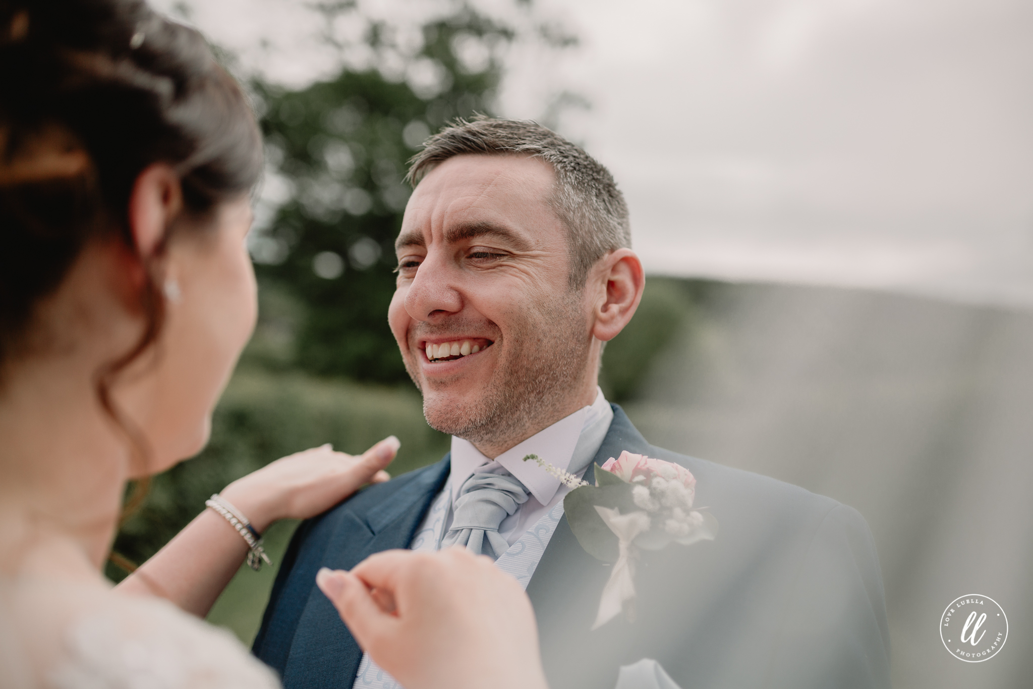 The groom looking at his wife with pride